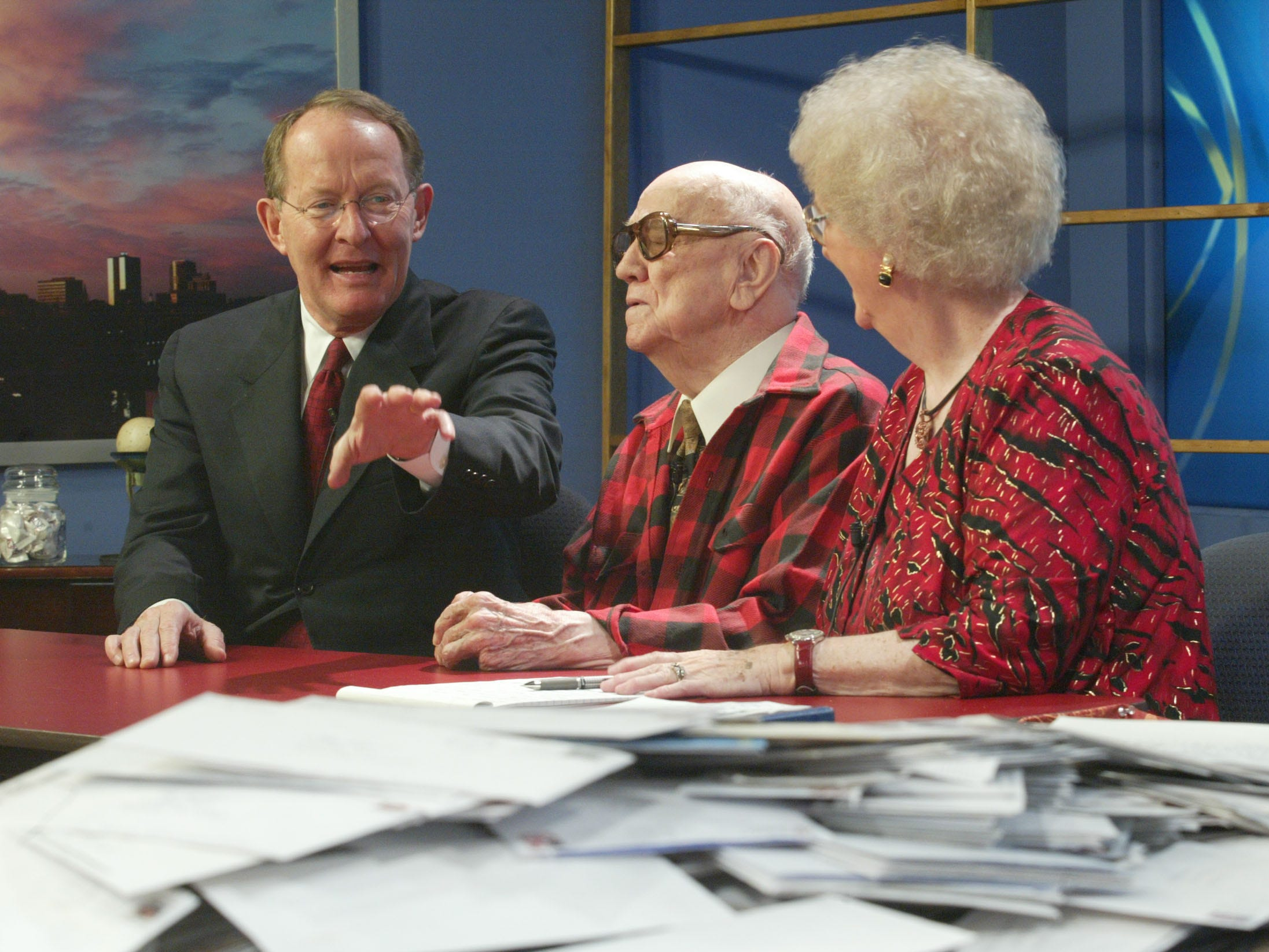 "U.S. Sen. Lamar Alexander gestures toward a pile of letters while talking with the Rev. J Bazzel Mull and his wife Elizabeth Mull during the taping of their weekly show, "" The Mull Singing Convention."" The letters, 10,854 total, were written by the show's audience to Sen. Alexander in response to the Mull's request due to worries that the phrase ""Under God"" may be taken out of the pledge of alliegence."