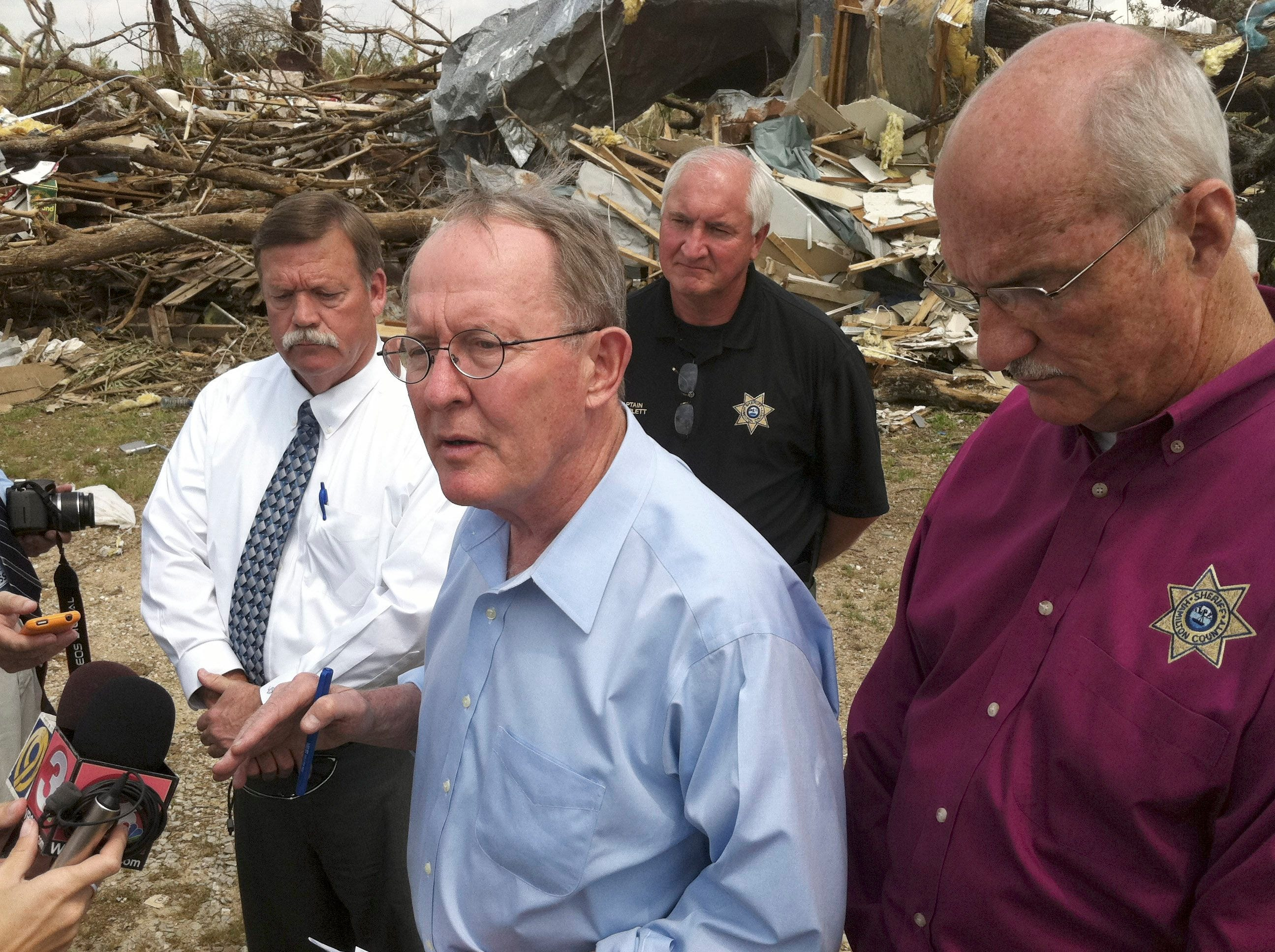 Tennessee U.S. Sen. Lamar Alexander, center, speaks with officials in Apison, Tenn. Monday, May 2, 2011. The small Tennssee town was one of many ravaged by severe storms and tornadoes on April 27.