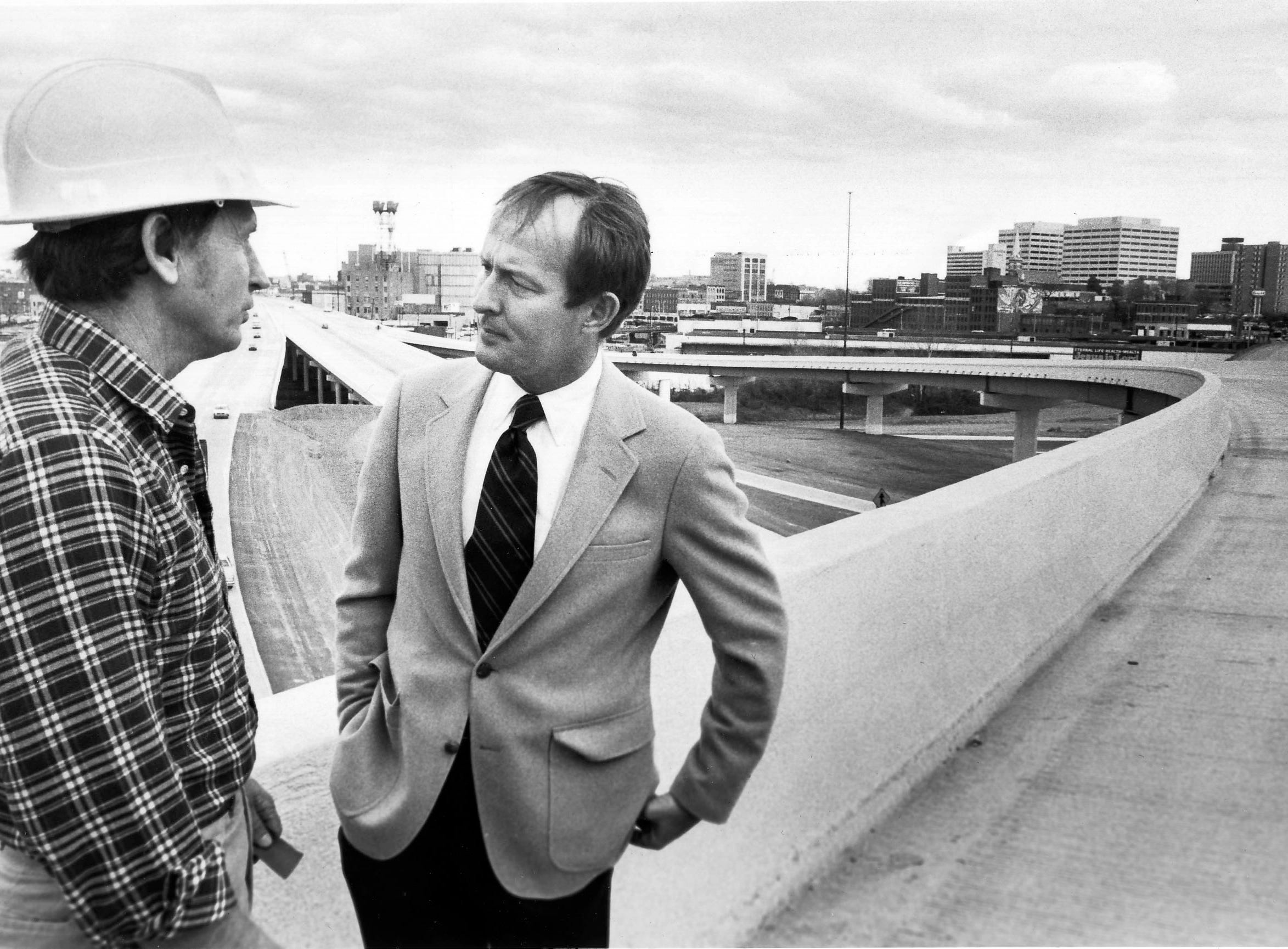 In a March 31, 1982, photograph, Gov. Lamar Alexander, right, talks with William Bell of Dement Construction Company during a ribbon cutting ceremony for the revamped Interstate 40/ 75 intersection known as Malfunction Junction.
