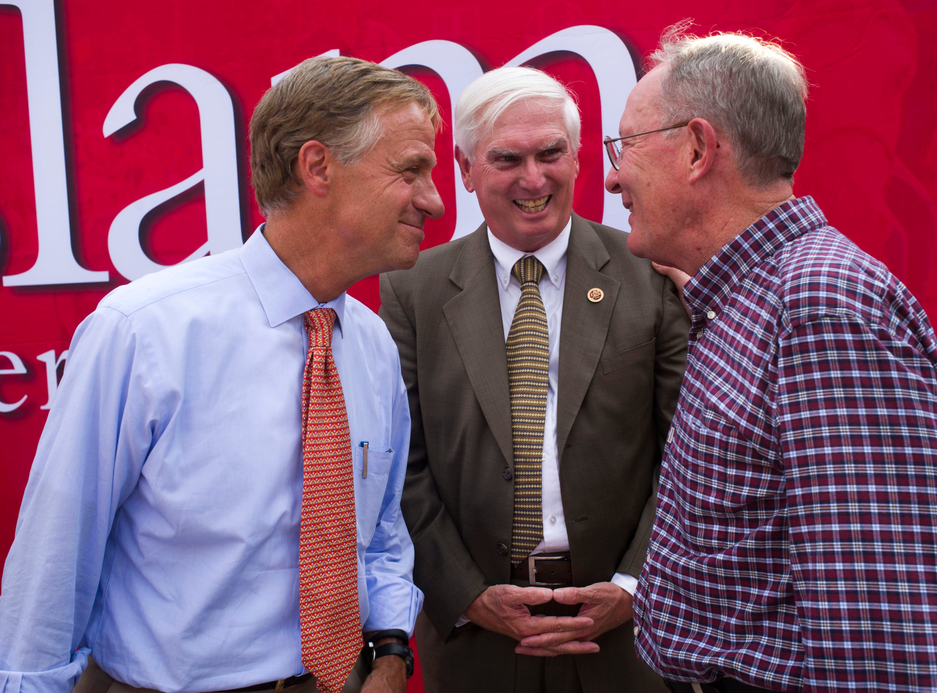Gov. Bill Haslam, left, U.S. Rep. John J. Duncan Jr., and U.S. Sen. Lamar Alexander share the stage during a get out the vote rally Wednesday, Aug. 6, 2014, at Cherokee Mills. Alexander is being challenged by state Rep. Joe Carr and Memphis radio station owner George Flinn for his senate seat.
