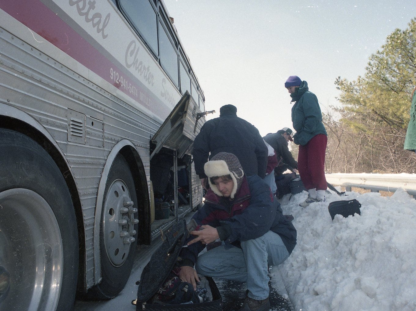 Kendall Howard, student at Bainridge College, goes through his personal belongings after their bus left them stranded on I-40 near the West Hills exit in February 1996. Students were transported by K-Trans to warm facilities until a bus was ready to carry them to their final destination.