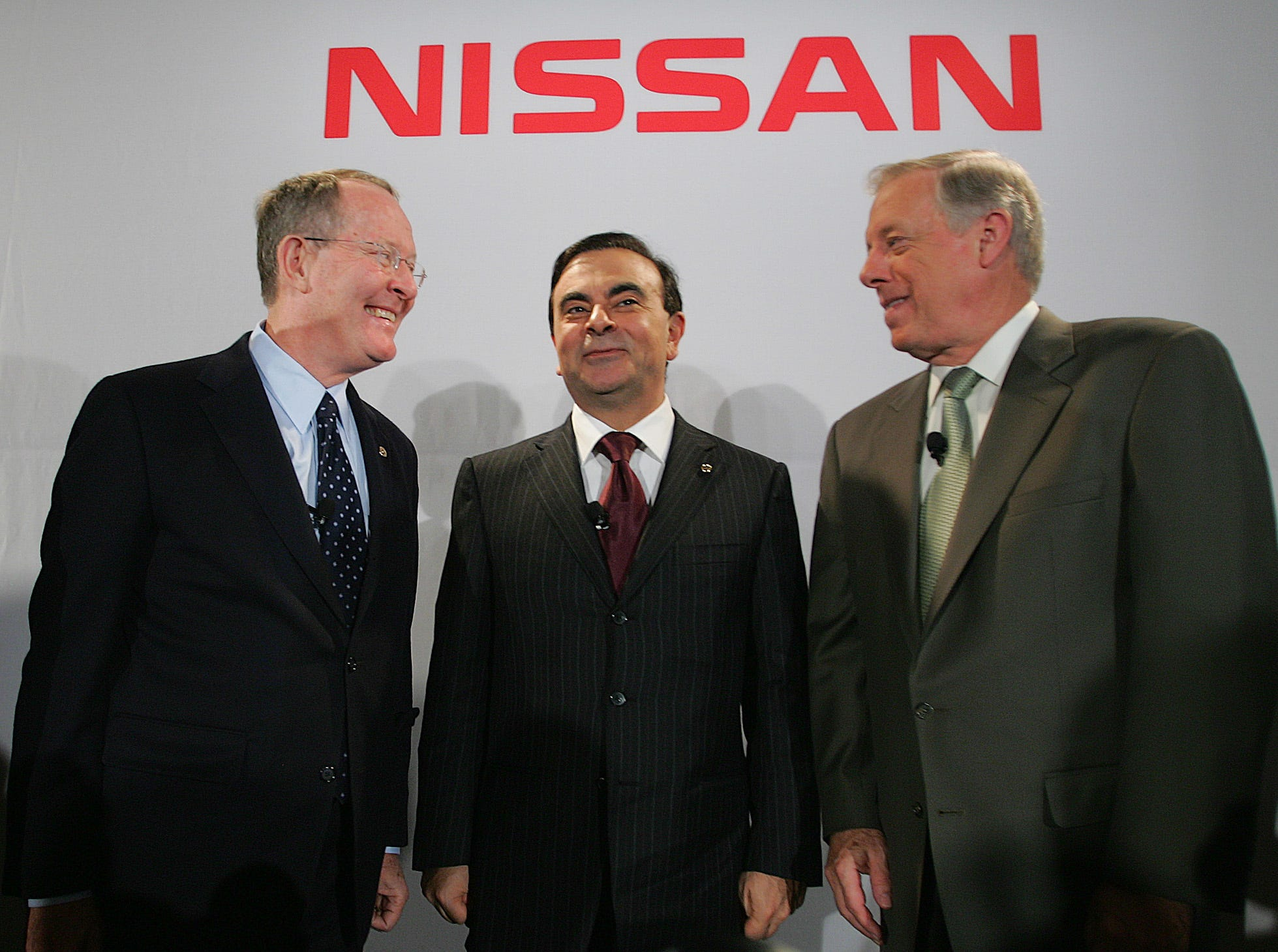 Sen. Lamar Alexander, R-Tenn., left, talks with Nissan President and CEO Carlos Ghosn, center, and  Gov. Phil Bredesen after announcing the relocation of Nissan North American headquarters to middle Tennessee in Nashville, Tenn., Thursday, Nov. 10, 2005.