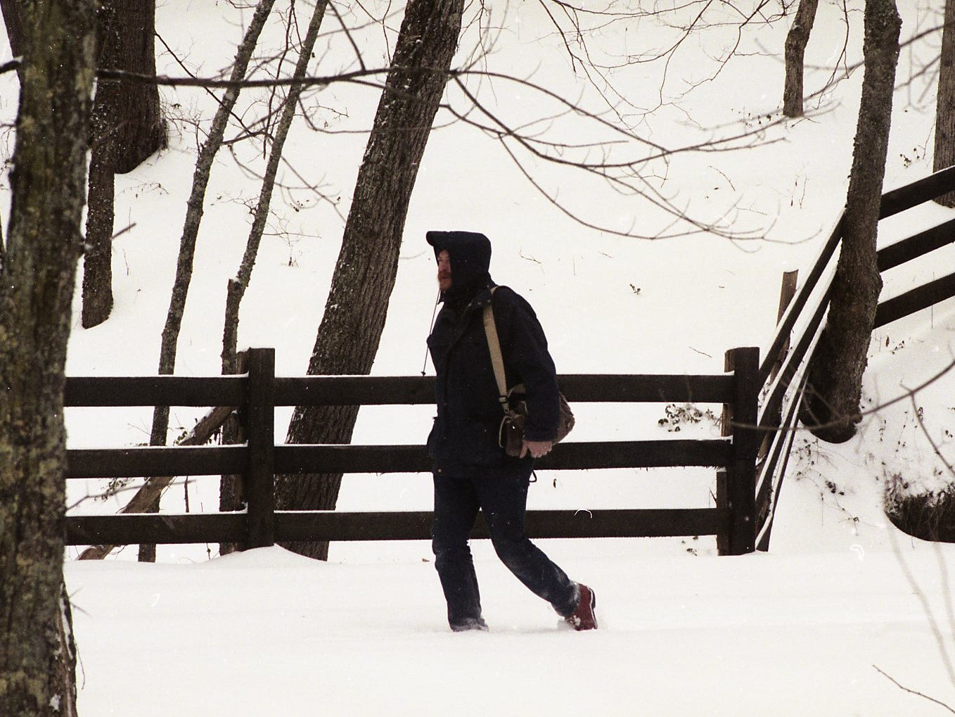 Kenneth Pace strolls through the woods of his property off Northshore Drive, enjoying the scenic splendor of this weekend's snow in February 1996.