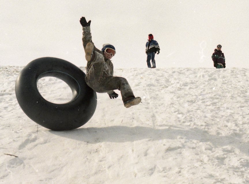 Dwight Garner, 10, flies high after taking on a hill that runs adjacent to Ebenezer Road in West Knoxville in February 1996.