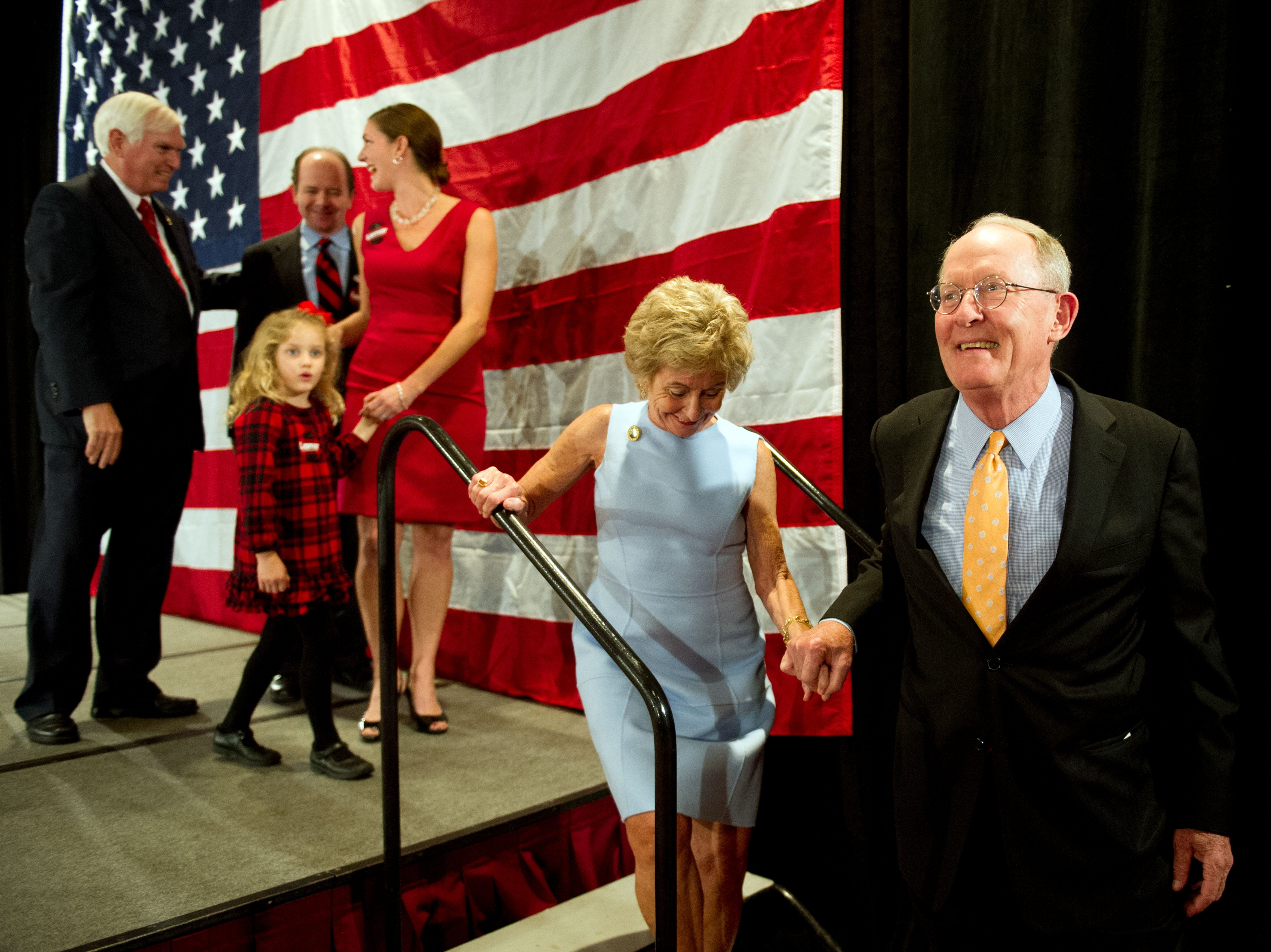 Senator Lamar Alexander smiles into the crowd after thanking his supporters at the Crowne Plaza on Tuesday, November 4, 2014. With him is his wife Honey Alexander.
