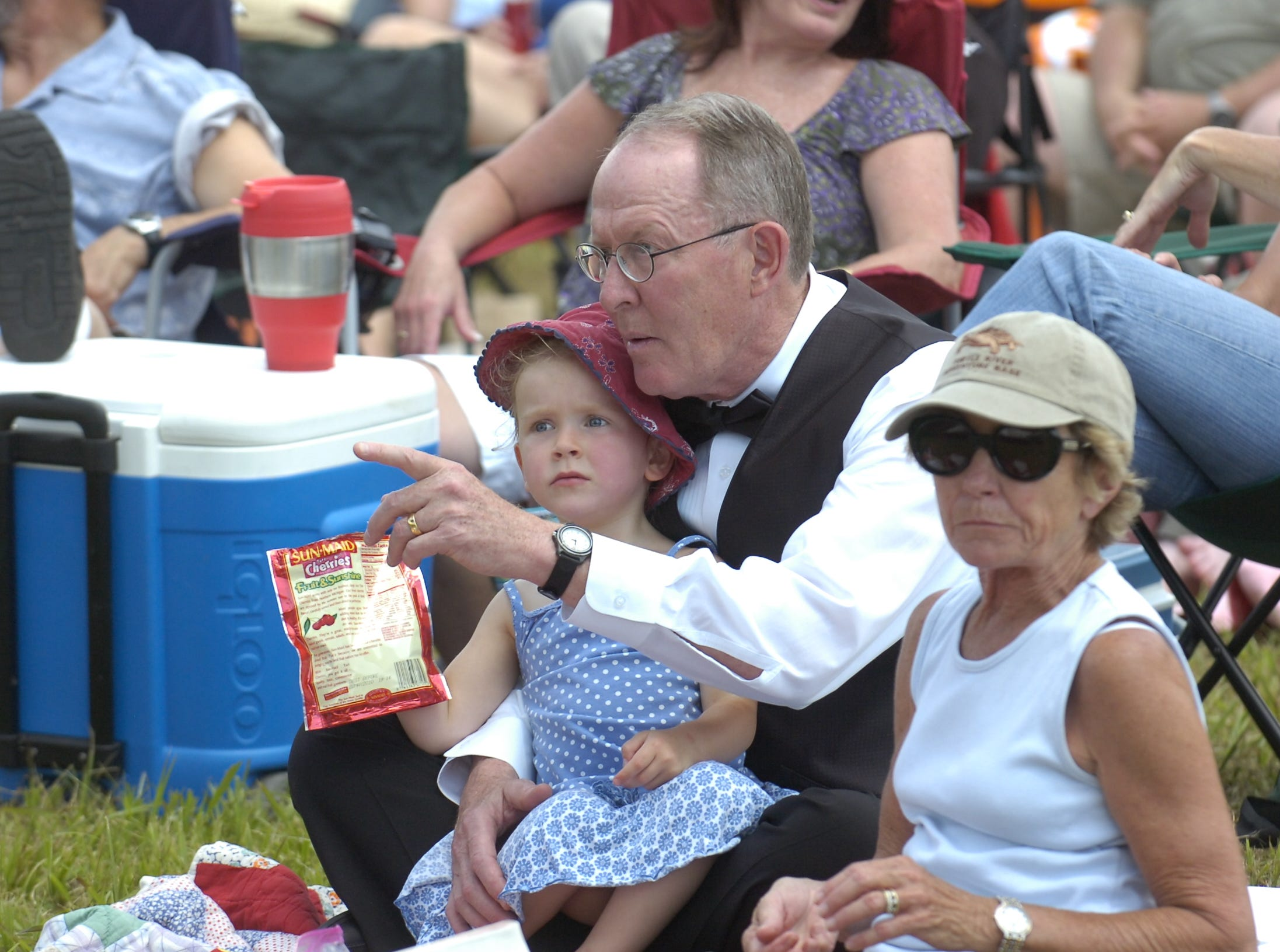 Senator Lamar Alexander sits with his granddaughter, three year-old Taylor Irwin, and wife Honey Alexander as they listen during the 75th Anniversary Celebration Concert in Cades Cove featuring the Knoxville Symphony Orchestra and Senator Alexander. The event drew and estimated 5,000 concertgoers to the cove on Saturday afternoon.