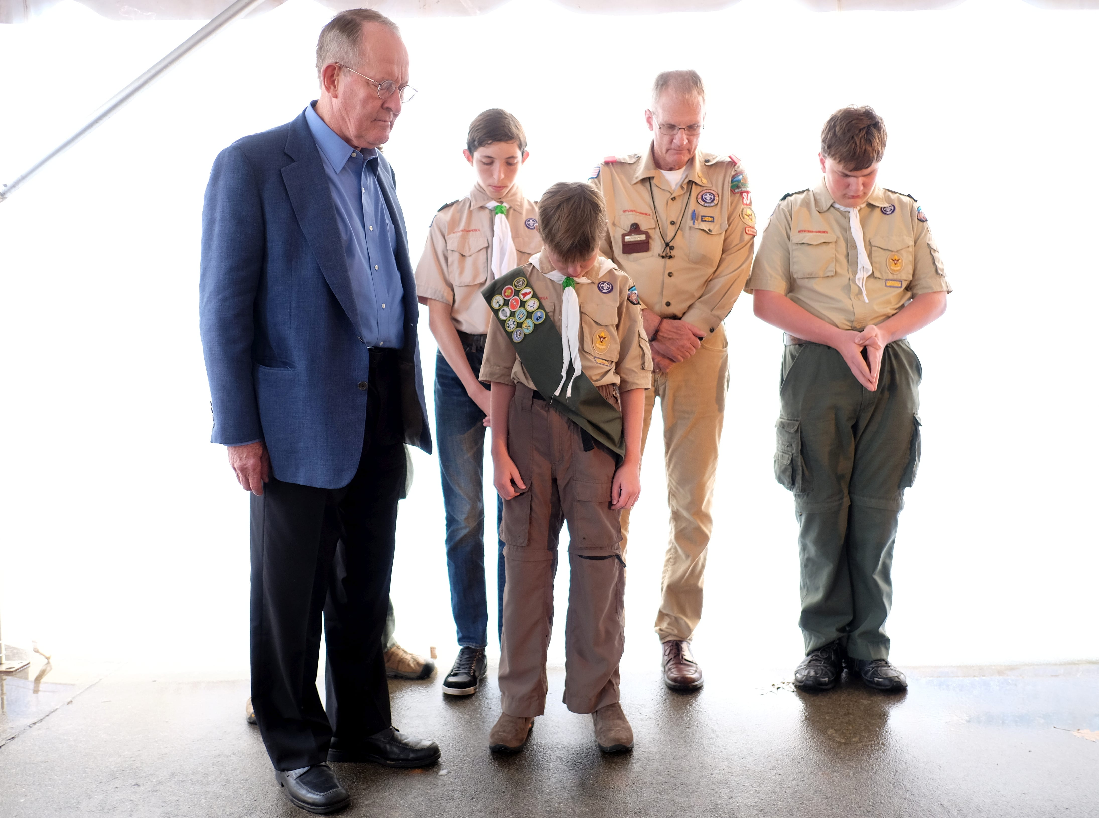 US Senator Lamar Alexander prays along side Boy Scout Troop 88 of Maryville during the Get Out the Vote Rally Tuesday, October 14, 2014 at Springbrook Park in Alcoa, Tenn.