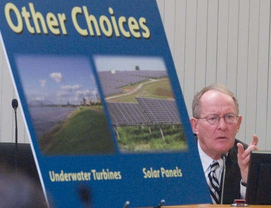 Tennessee Senator Lamar Alexander poses a question at  the  TVA Congressional Caucus forum on TVA's renewable electricity choices in Knoxville Thursday morning.   The forum was held in the main assembly room of the City and County building in downtown Knoxville.
