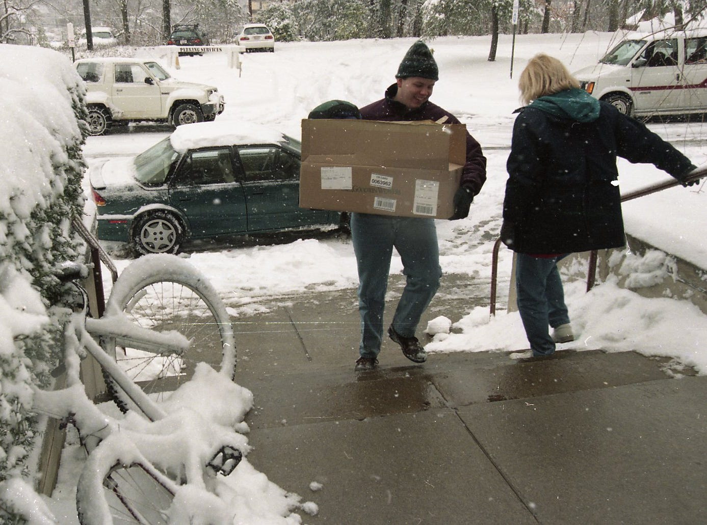 Trey Cole moves his belongings back to his UT dorm preparing for the new term. Cole came back from Memphis and was surprised to be moving back in the snow.