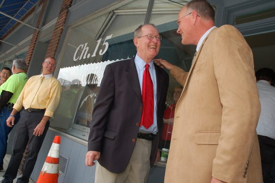 Roane County Executive Ron Woody, right, greets U.S. Sen. Lamar Alexander outside the new Roane County Channel 15 TV studio next to the historic Princess Theater on Monday, April 18, 2011. Watching at left is Harriman Police Chief Randy Heidle. Alexander toured the Princess, now undergoing restoration.
