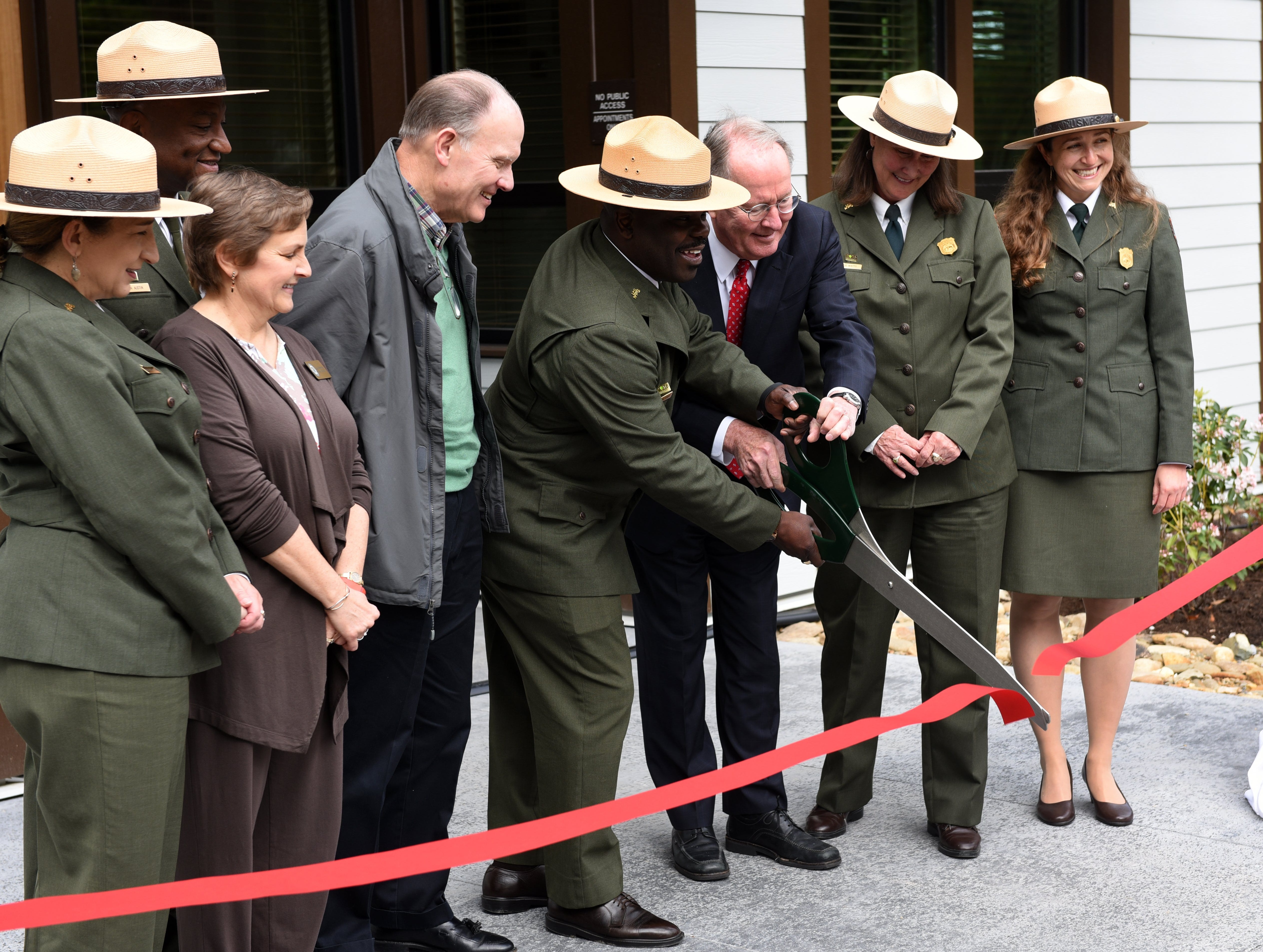The National Park Service opened its Collections Preservation Center in East Tennessee to maintain items from five parks in Appalachia Friday, May 6, 2016. Holding the scissors cutting the ribbon center are GSMNP Superintendent Cassius Cash and Senator Lamar Alexander. The 14,000-square-foot facility will allow the National Park Service to take care of more than 418,000 artifacts and 1.3 million archival records from the Andrew Johnson National Historic Site, Big South Fork National River and Recreation Area, Cumberland Gap National Historical Park, Great Smoky Mountains National Park and Obed Wild and Scenic River.