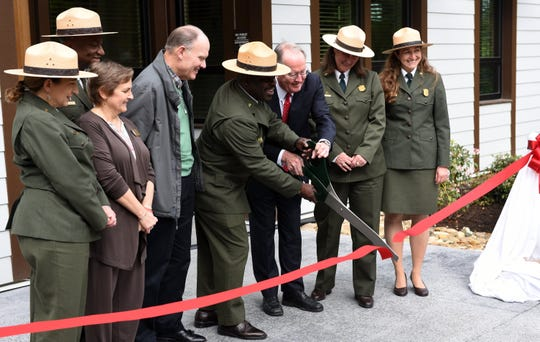 The National Park Service opened its Collections Preservation Center in East Tennessee to maintain items from five parks in Appalachia on May 6, 2016. Holding the scissors to cut the ribbon are Great Smoky Mountains National Park Superintendent Cassius Cash and Sen. Lamar Alexander.