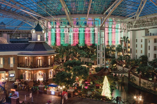 The Gaylord Opryland Resort & Convention Center's atrium showcases Christmas lights and decorations.