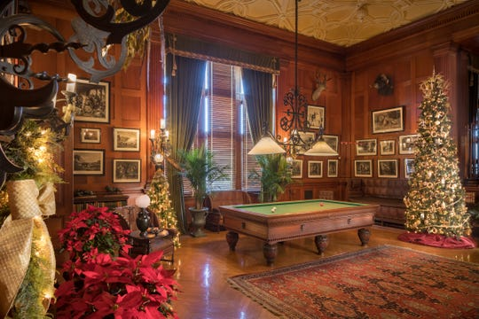 The Billiards Room at Biltmore Estate showcases Christmas decorations.