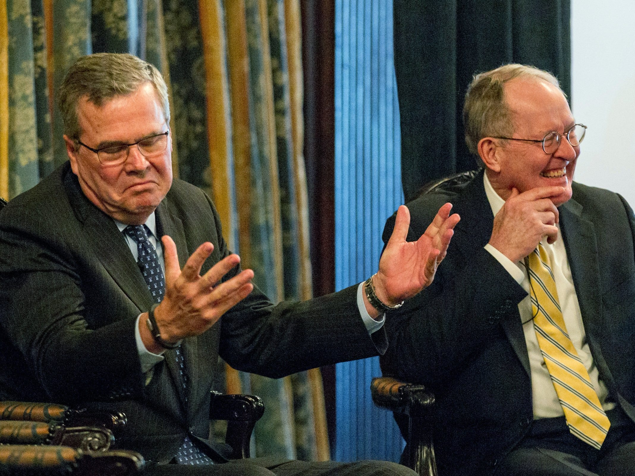 Former Florida Gov. Jeb Bush, left, gestures during at an education forum in Nashville, Tenn., on Wednesday, March 19, 2014 with U.S. Sen. Lamar Alexander, R-Tennr. Bush urged politicians to make the case to their constituents in favor of Common Core education standards.