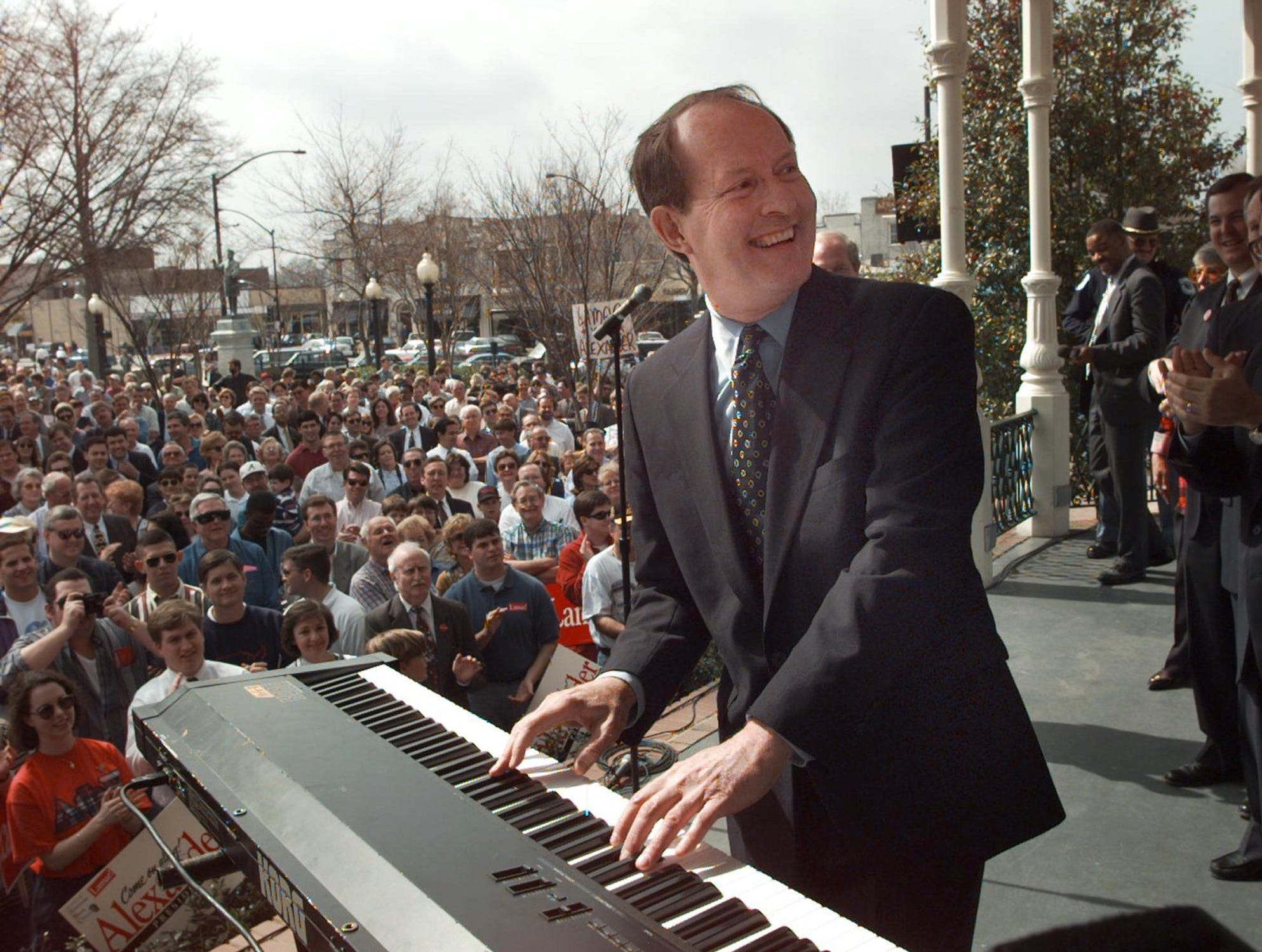 "Playing his campaign theme song, ""Alexander's Ragtime Band"", Lamar Alexander smiles back at photographers as the crowd claps along Monday, Feb. 26, 1996 in downtown Marietta, Ga."