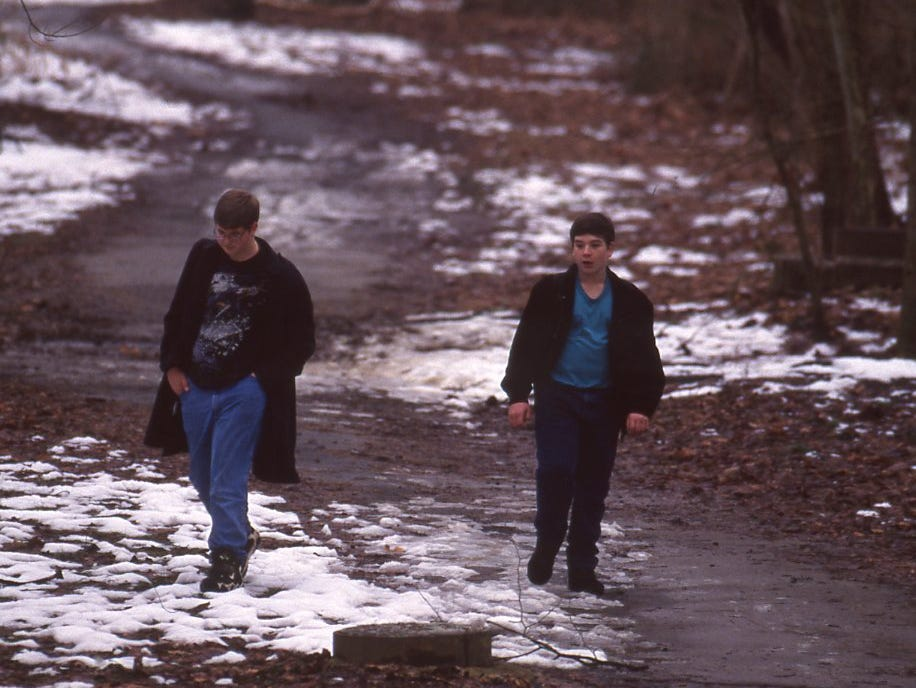 Patches of snow remain in the shaded areas of the Third Creek bike rail as Chris Lussenden and Jonathon Shipe walk in January 1996.