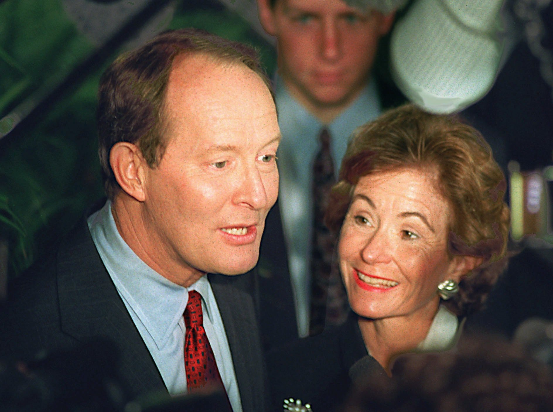 Facing the crush of the media for the final time in this campaign, presidential hopeful Lamar Alexander and his wife Honey make their way through the crowd after announcing his withdrawal from the race Wednesday, March 6, 1996 in Nashville, Tenn. In announcing his withdrawal, Alexander pledged his support to Republican front-runner Bob Dole.