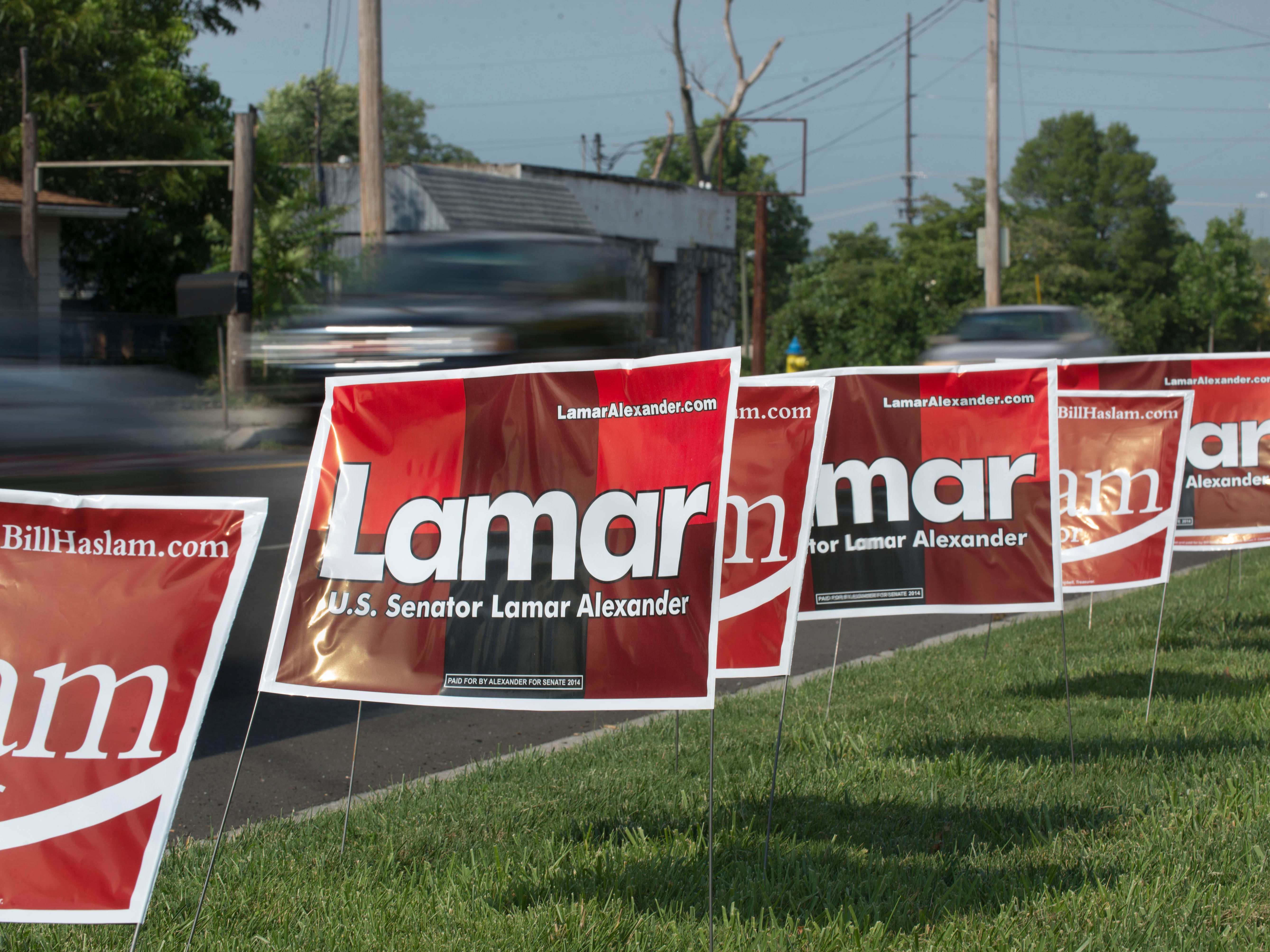 Campaign signs for U.S. Sen. Lamar Alexander and Gov. Bill Haslam line Sutherland Avenue for a get out the vote rally Wednesday, Aug. 6, 2014, at Cherokee Mills. State Rep. Joe Carr and Memphis radio station owner George Flinn are challenging Alexander for a senate seat.