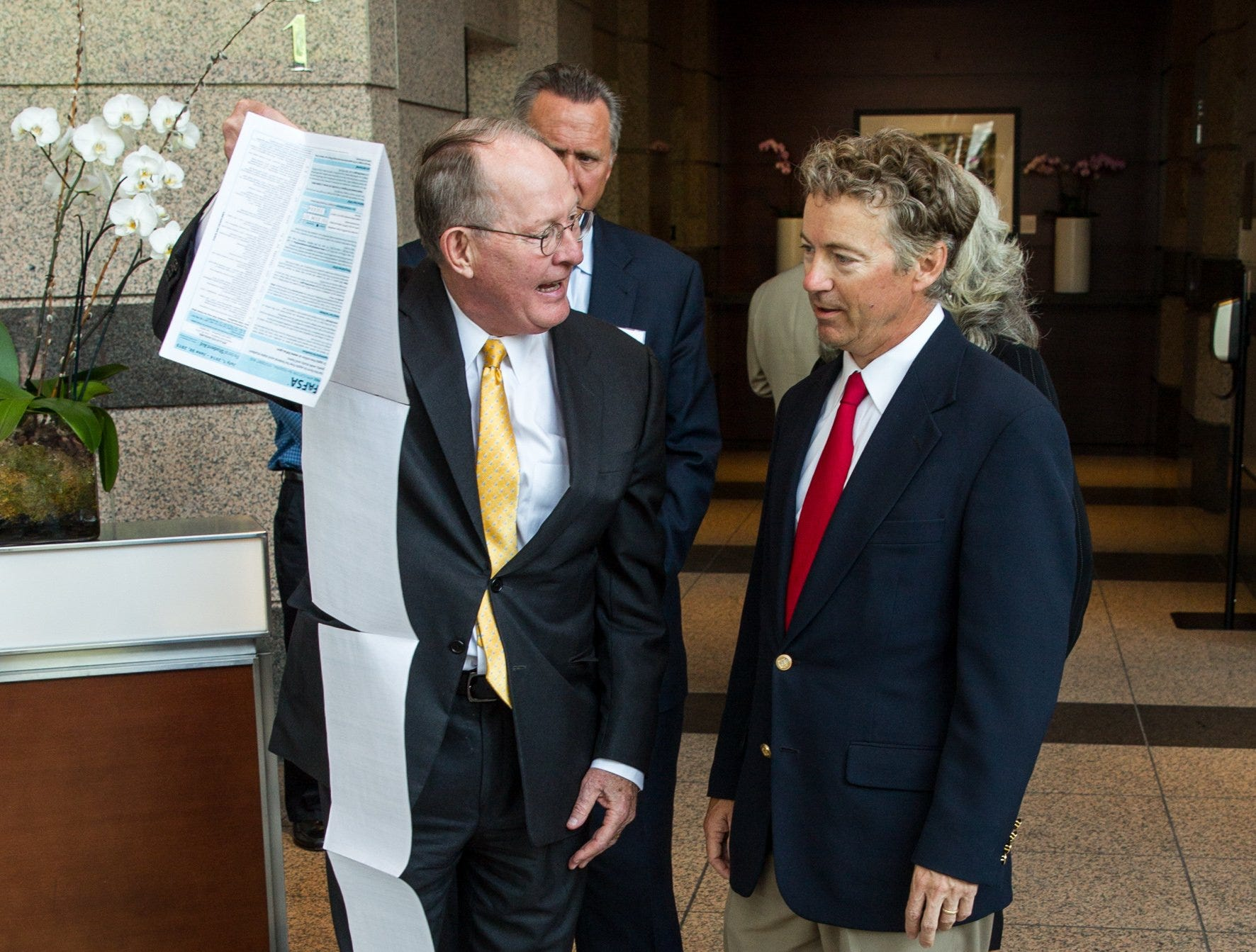 U.S. Sens. Lamar Alexander, R-Tenn., left,  and Rand Paul, R-Ky., discuss the federal student application for financial assistance after a press conference in Nashville, Tenn., on Monday, June 30, 2014.