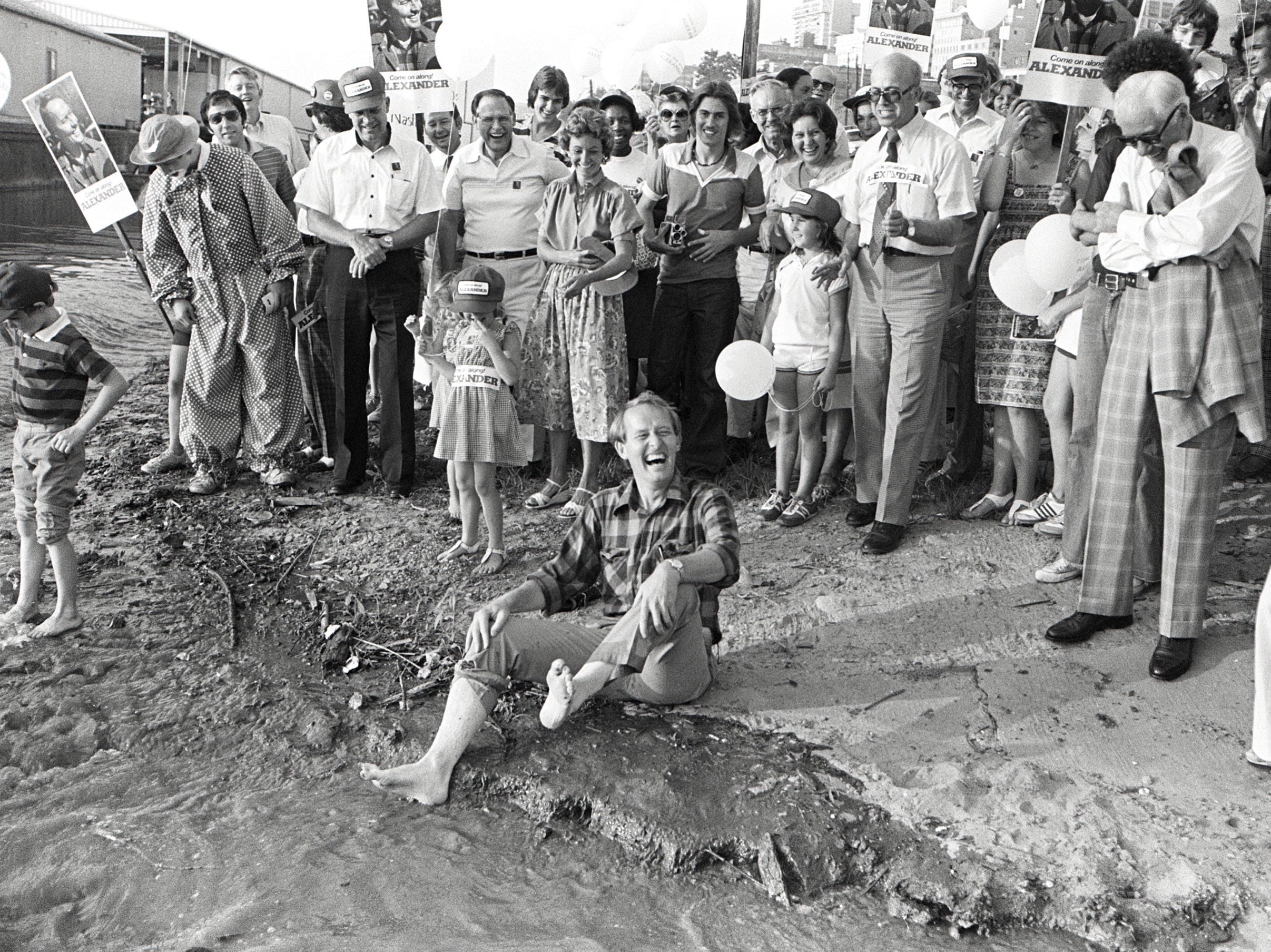 Tennessee Republican gubernatorial candidate Lamar Alexander shares a laugh with supporters as he soaks his feet in the waters of the Mississippi River on 6 July 1978.  He had walked the entire length of the state during his successful campaign.