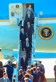 President George H.W. Bush arrives for a science and math education forum on Feb. 19, 1992, at McGhee Tyson Air National Guard base. He is followed by Rep. Jimmy Quillen, Rep. John J. Duncan Jr., Rep. Don Sundquist, Assistant to the President Arnold Havens, Secretary of Energy James Watkins, and Secretary of Education Lamar Alexander.