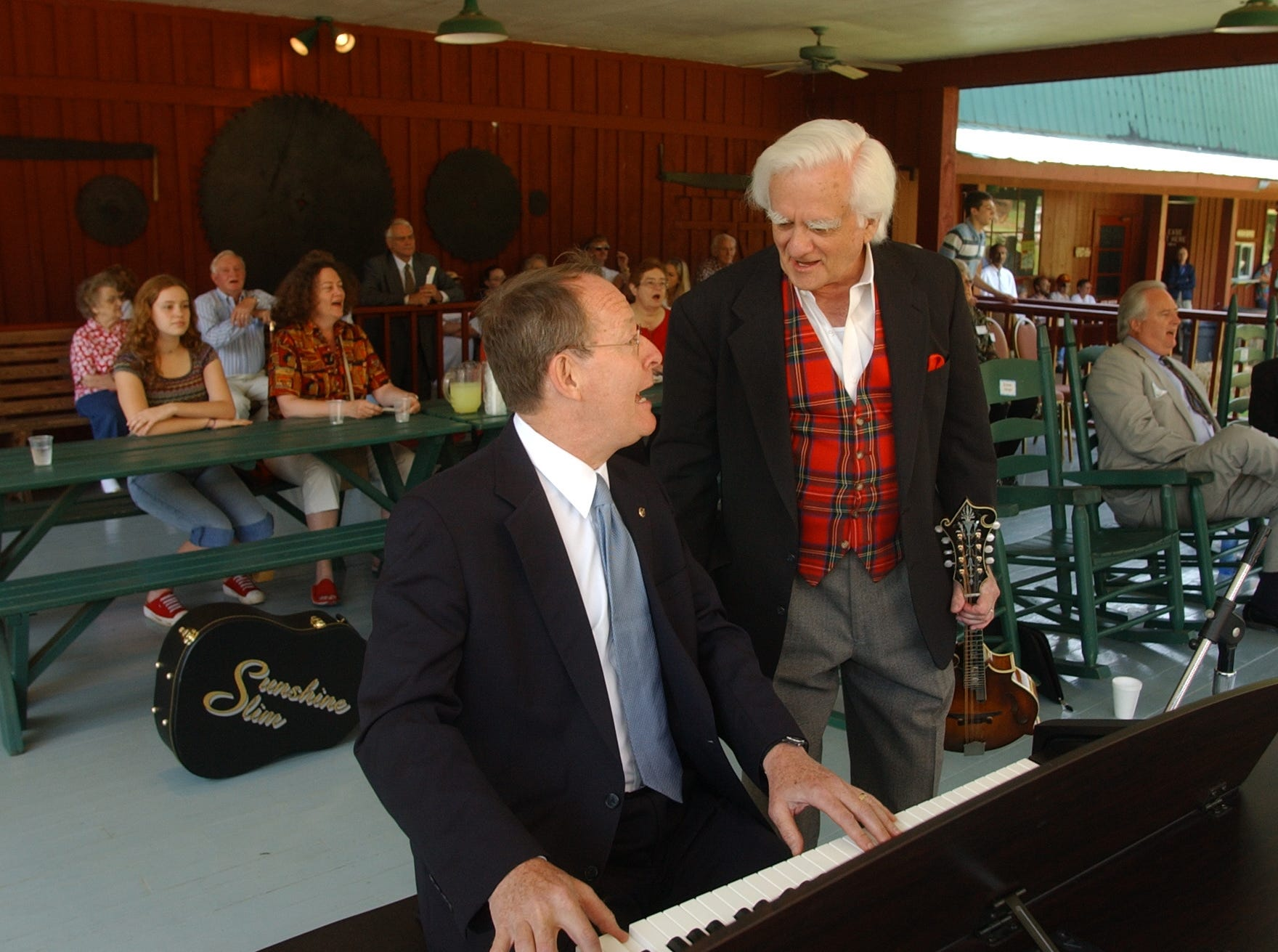 "U.S. Senator Lamar Alexander R-Tenn.,  plays the piano and talks with John Rice Irwin, Museum founder and President during ceremonies Wednesday morning. A host of dignitaries and local people gathered at the Museum fof Appalachia  for what the founder of the Anderson County cultural instuation called a ""Grand Opening and Grand Grand Giveway"".   John Rice Irwin, the founder of the Museum fo Appalachia in Norris 35 years ago held a ribbon cutting 35 years after the museum opened and then turned the whole organization over to a nonprofit foundation."