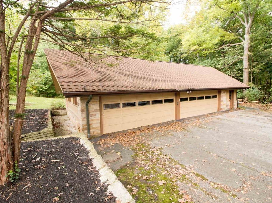 Secluded off US 231 down a long lane sits the home of your childhood dreams, equipped with a 50 foot pool and racquetball court to name a few amenities.