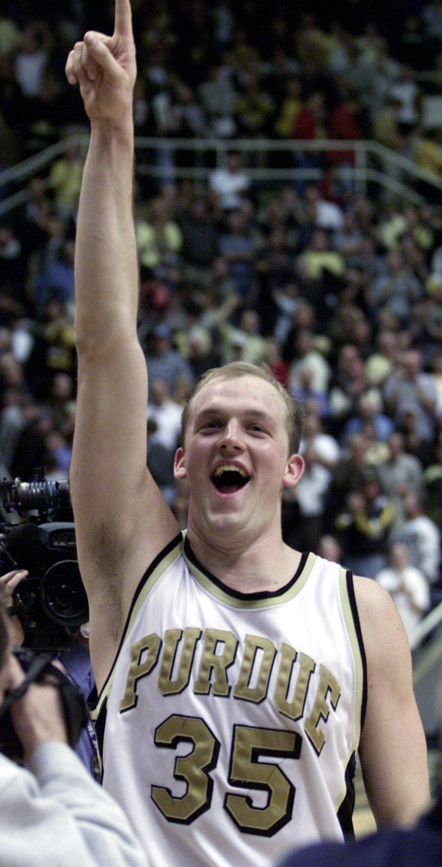 Purdue's Brian Cardinal signals to the crowd moments after the Boilers beat Michigan State 70-67 on February 8, 2000 at Mackey Arena.
