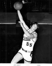 John Garrett, a 6-11 center from Peru, Ind., scored 1,620 points in three seasons with the Boilermakers.