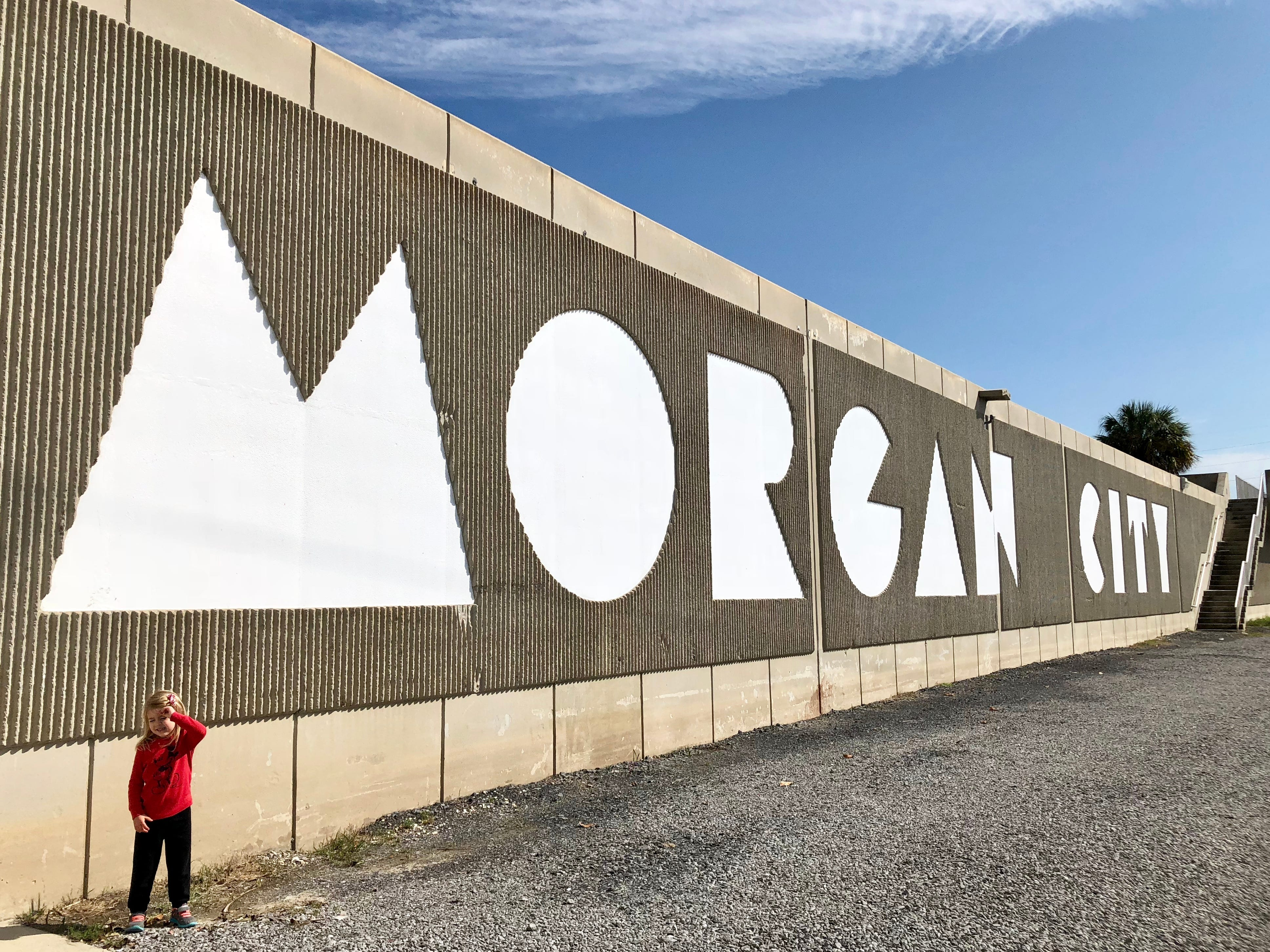 """Avery Guidry, 4, stands in front of """"The Great Wall"""" in Morgan City, an elevated part of the historic Front Street that overlooks the Atchafalaya. Reporter Leigh Guidry and family visited this as they took the Bayou Teche Byway."""
