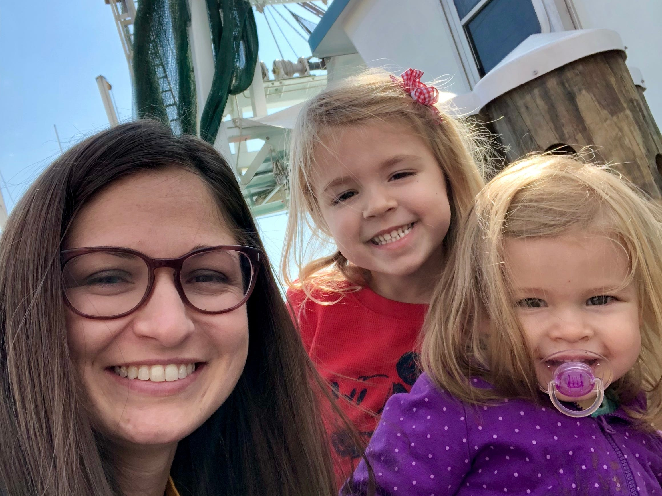 Reporter Leigh Guidry snaps a selfie with her daughters Avery and Marie in front of a shrimp boat on the Atchafalaya during their stop in Morgan City along the Bayou Teche Byway.
