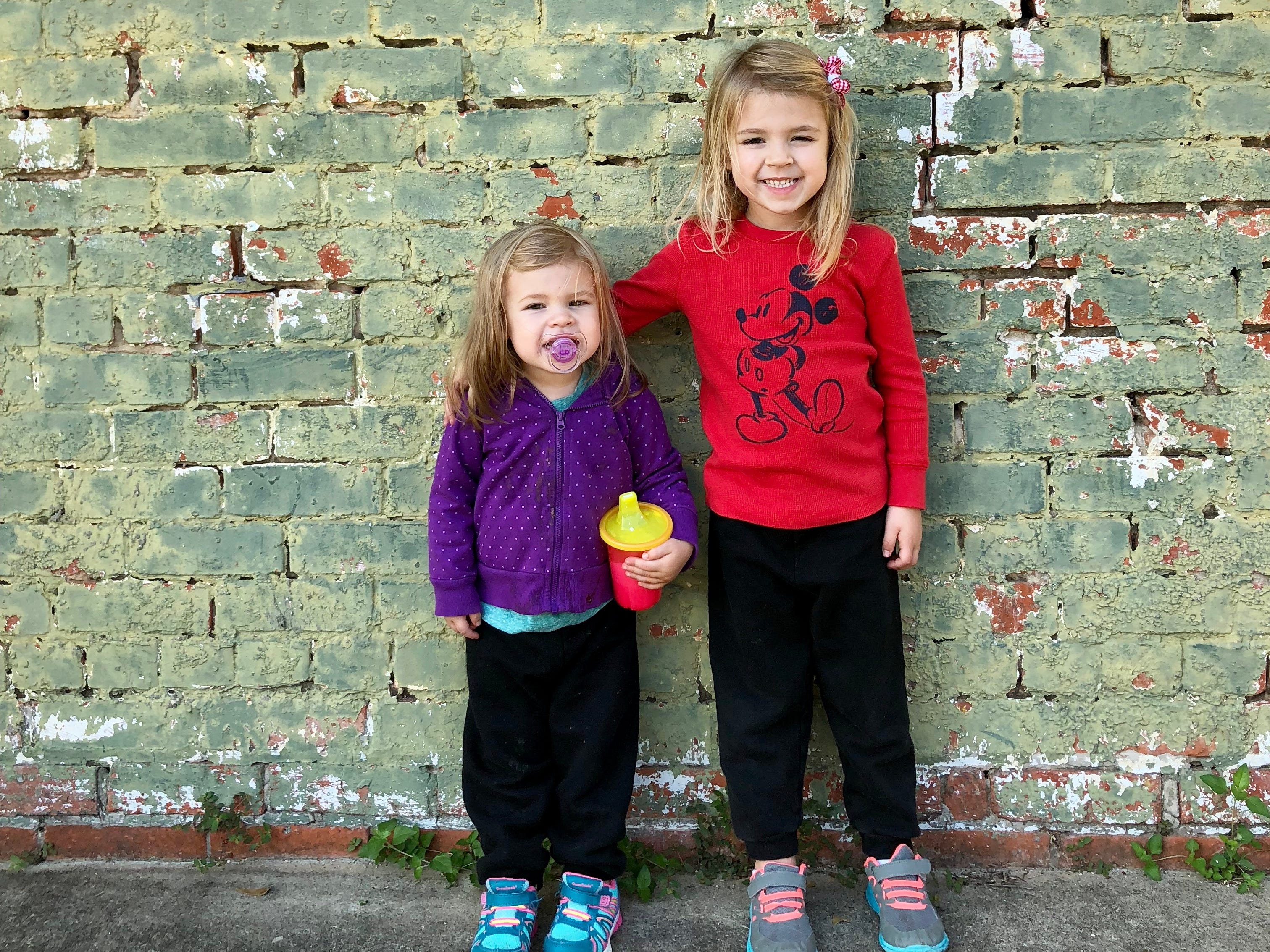 Avery and Marie Guidry pose for a photo in historic downtown Morgan City as their family tours the Bayou Teche Byway.