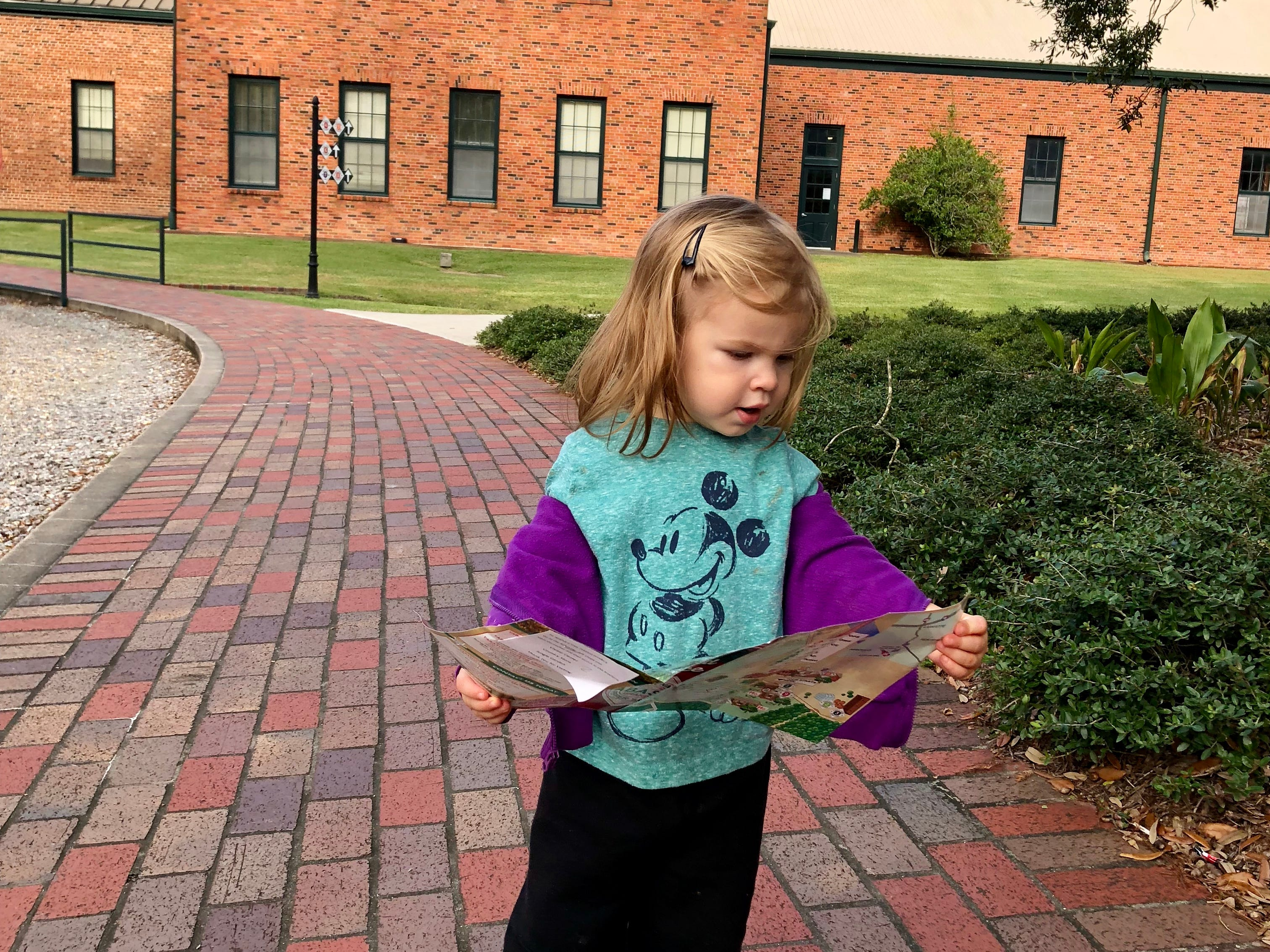 Marie Guidry, almost 2, is in charge as her family takes a tour of the Tabasco plant at Avery Island.