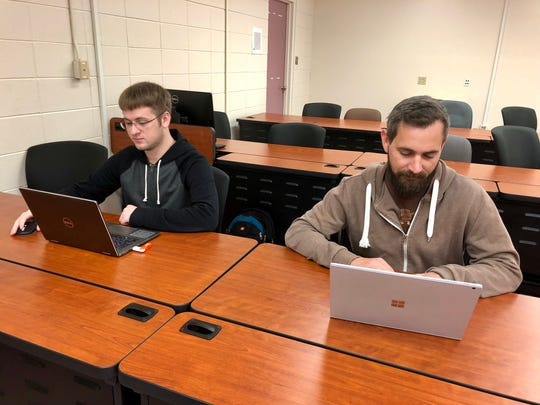 Michael Hagan and Tim Spotswood are students in South Louisiana Community College's application software development program. Spotswood, a veteran, got a tech job after starting school at a community college. He'd been out of the classroom for 12 years.