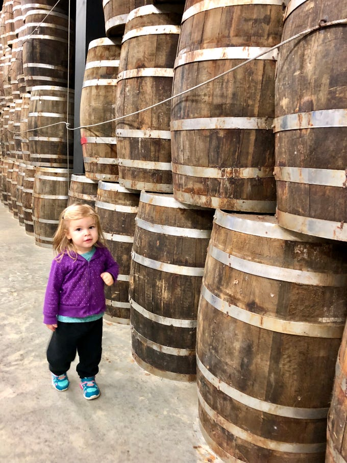 Marie Guidry, almost 2, checks out the barrels on display at the Tabasco plant at Avery Island.
