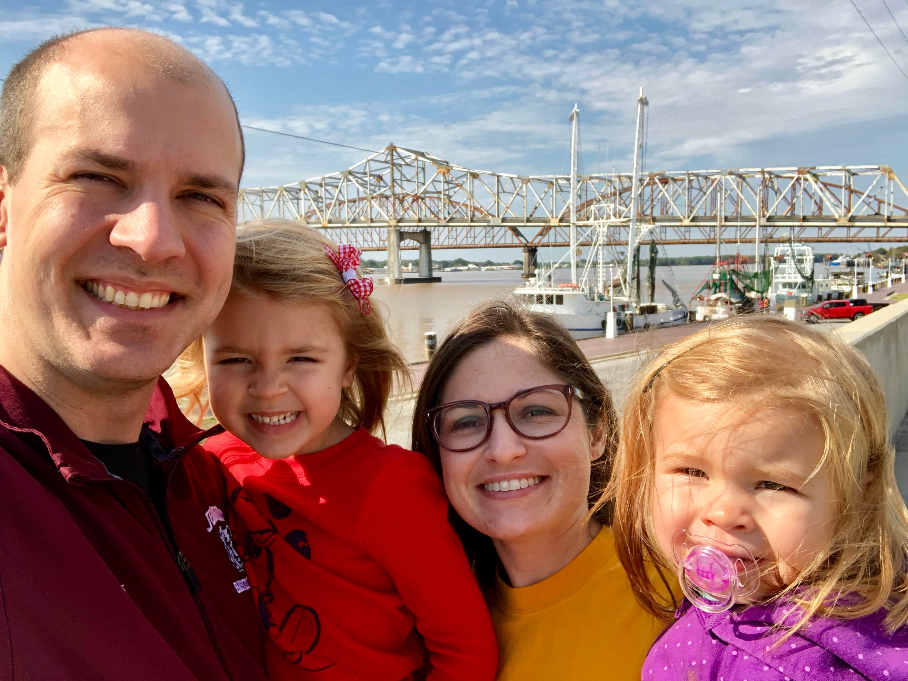 """Travel and tourism reporter Leigh Guidry and her family check out Morgan City as they tour the Bayou Teche Byway. They stand on the """"Great Wall"""" that overlooks historic Front Street and the Atchafalaya."""
