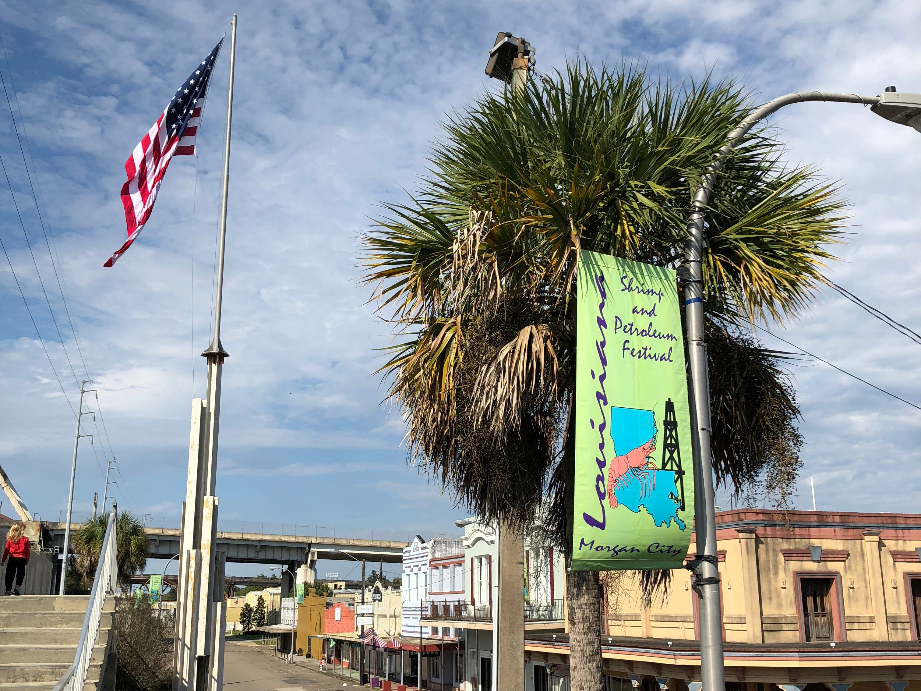 """Travel and tourism reporter Leigh Guidry and her family check out Morgan City as they tour the Bayou Teche Byway. The """"Great Wall"""" overlooks historic Front Street and the Atchafalaya. The city is known for its annual Shrimp and Petroleum Festival."""