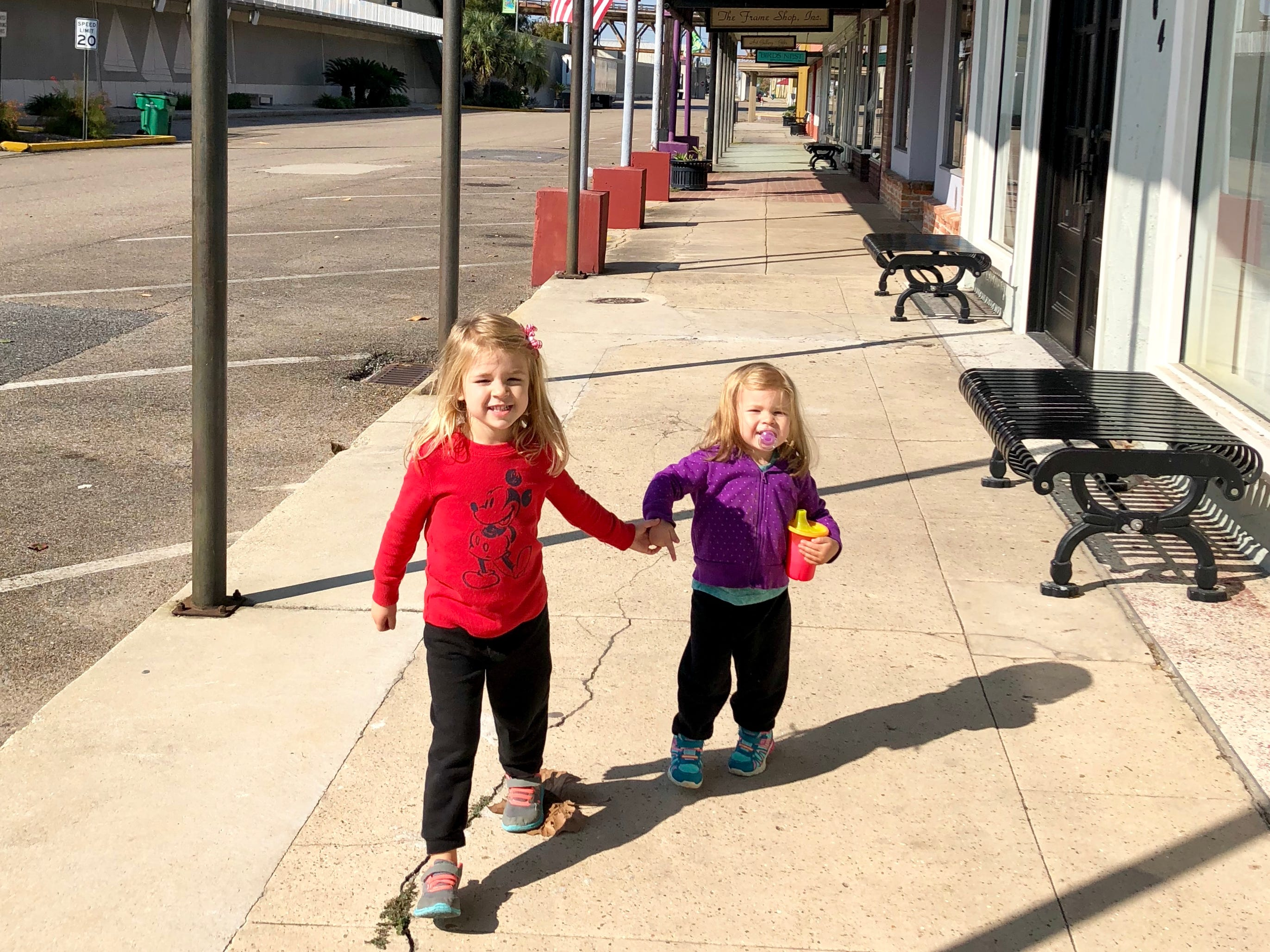 Avery and Marie Guidry walk down Front Street in historic downtown Morgan City as their family tours the Bayou Teche Byway.