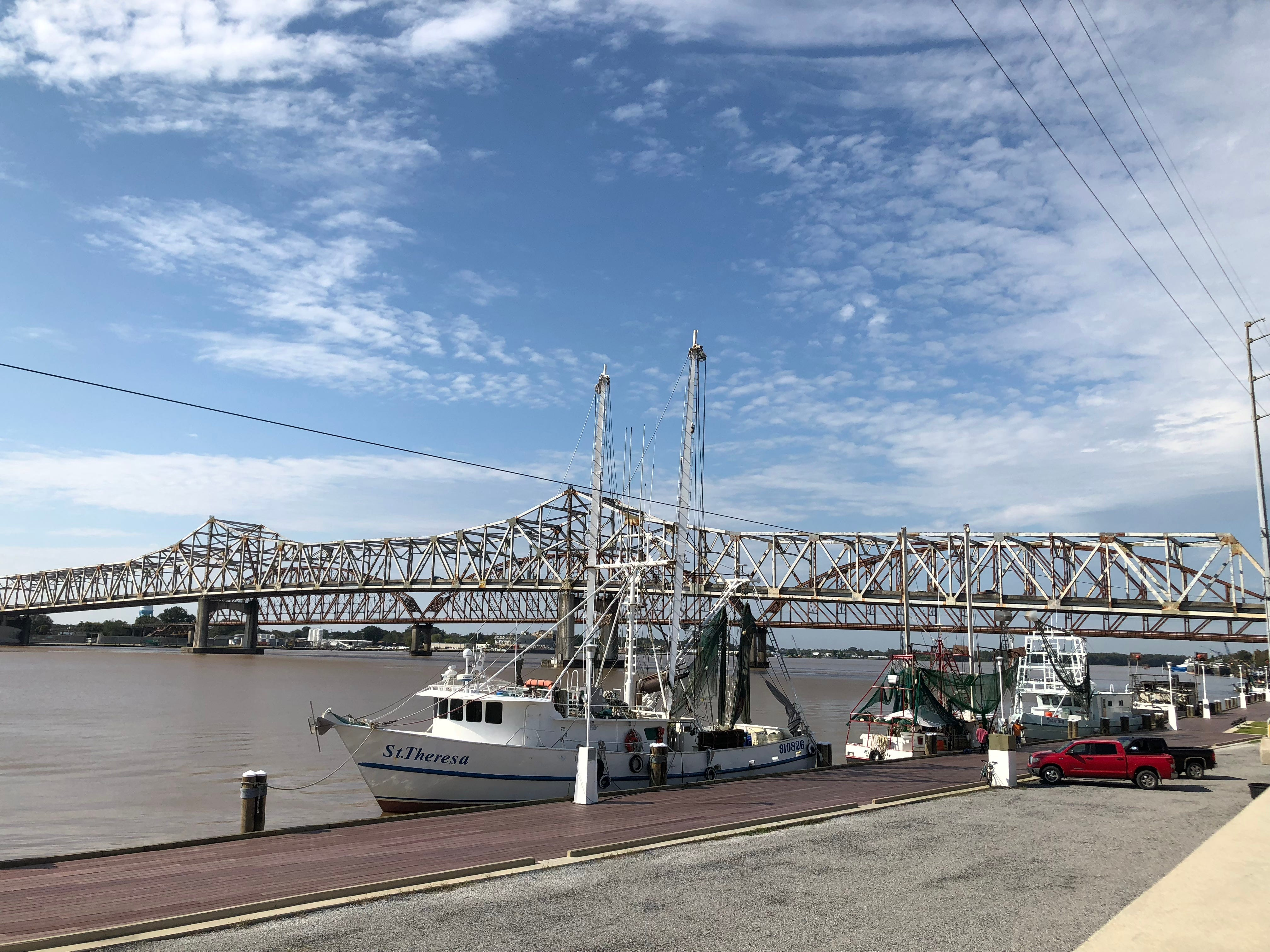 """Travel and tourism reporter Leigh Guidry and her family check out Morgan City as they tour the Bayou Teche Byway. The """"Great Wall"""" overlooks historic Front Street and the Atchafalaya."""