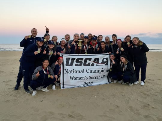Cleary University's women's soccer team celebrates its national championship in Virginia Beach, Va. on Sunday, Nov. 11, 2018.