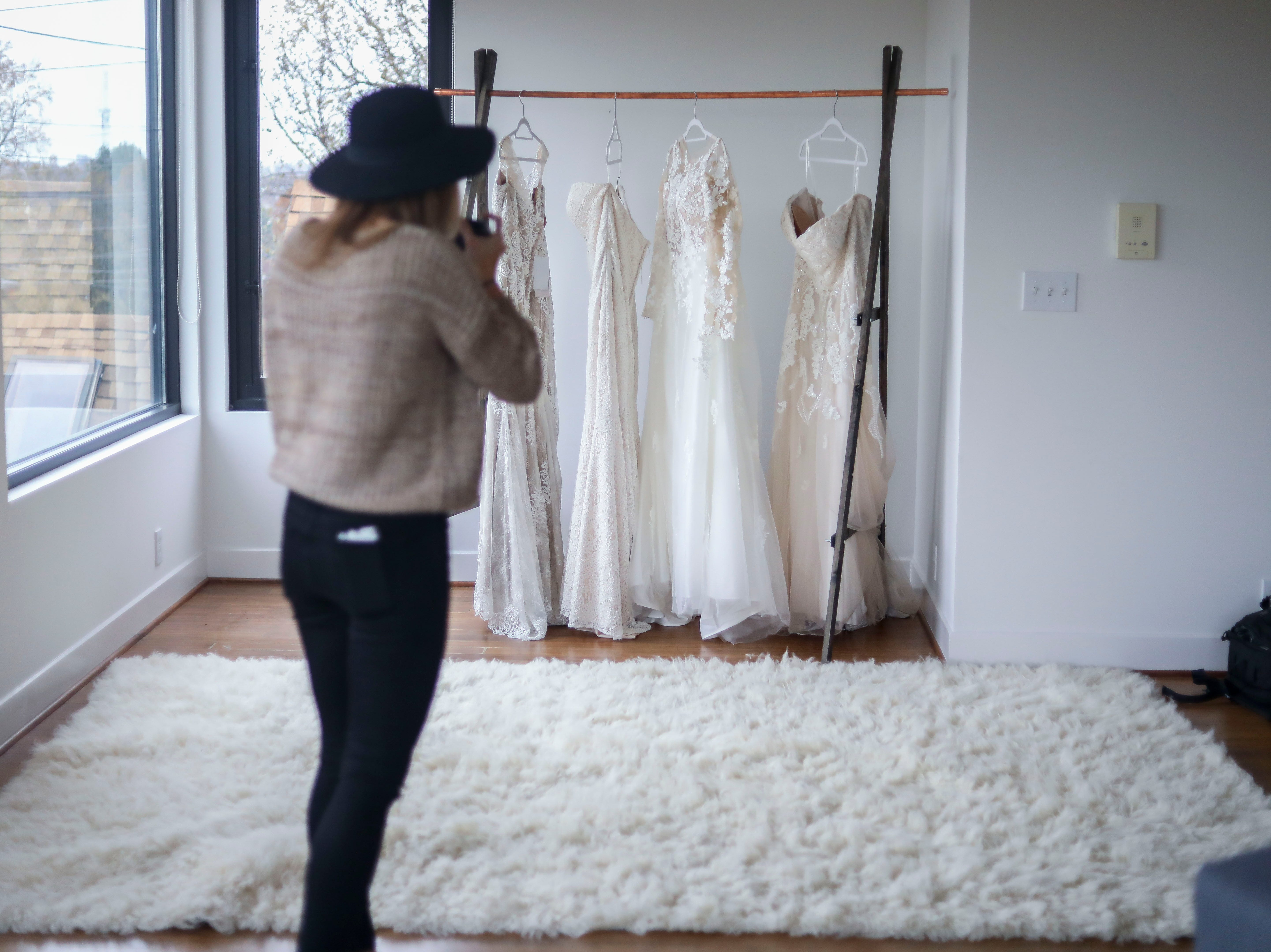 Susan Jordan of Love Hunters, tests the lighting ahead of a Couture Closet Bridal photoshoot featuring brides in their actual wedding dresses in NuLu in Louisville, Ky. on Monday, November 12, 2018.
