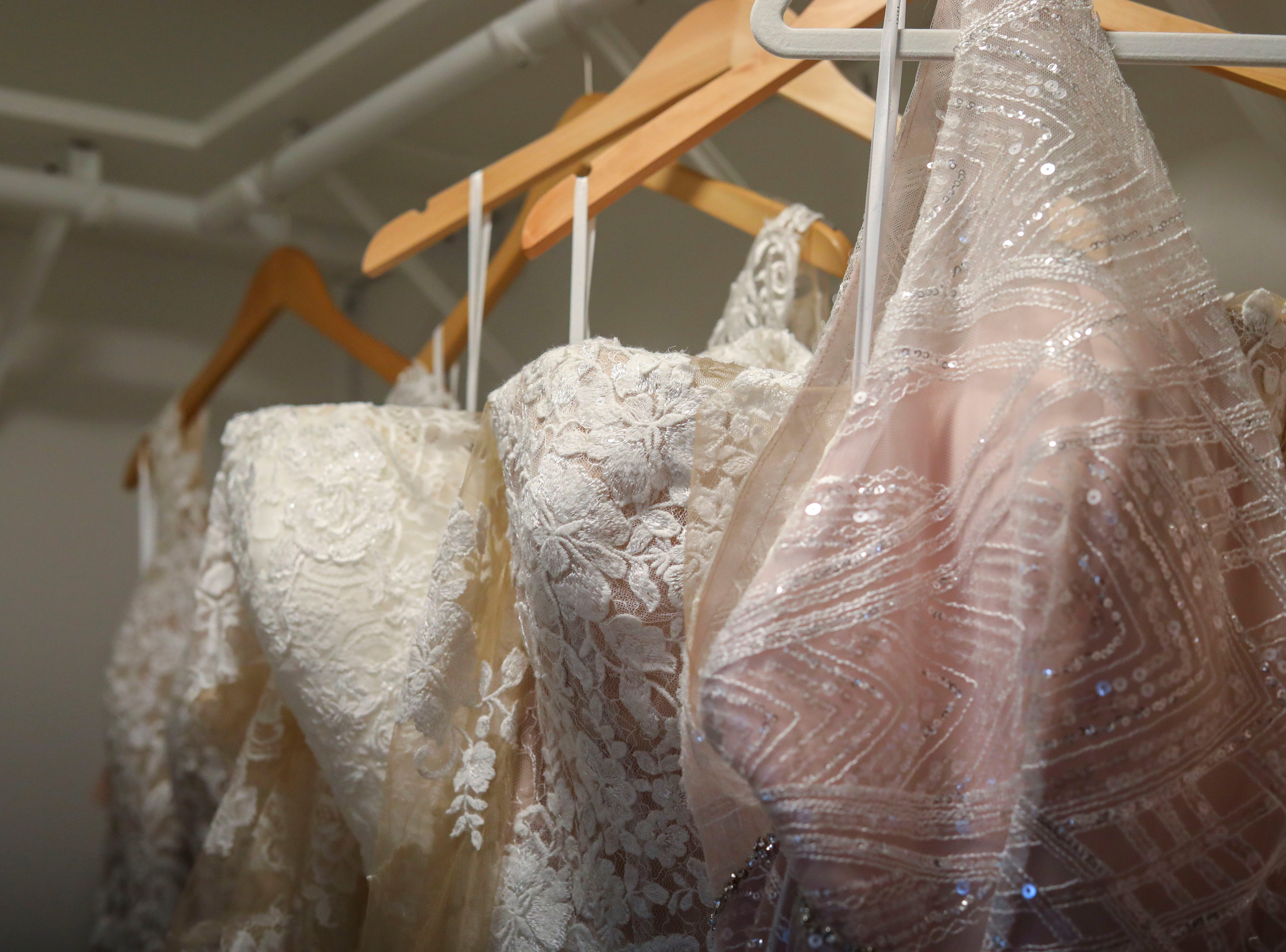 Dresses from Couture Closet Bridal hang before a photoshoot, featuring actual brides in their wedding dresses in NuLu in Louisville, Ky. on Monday, November 12, 2018.