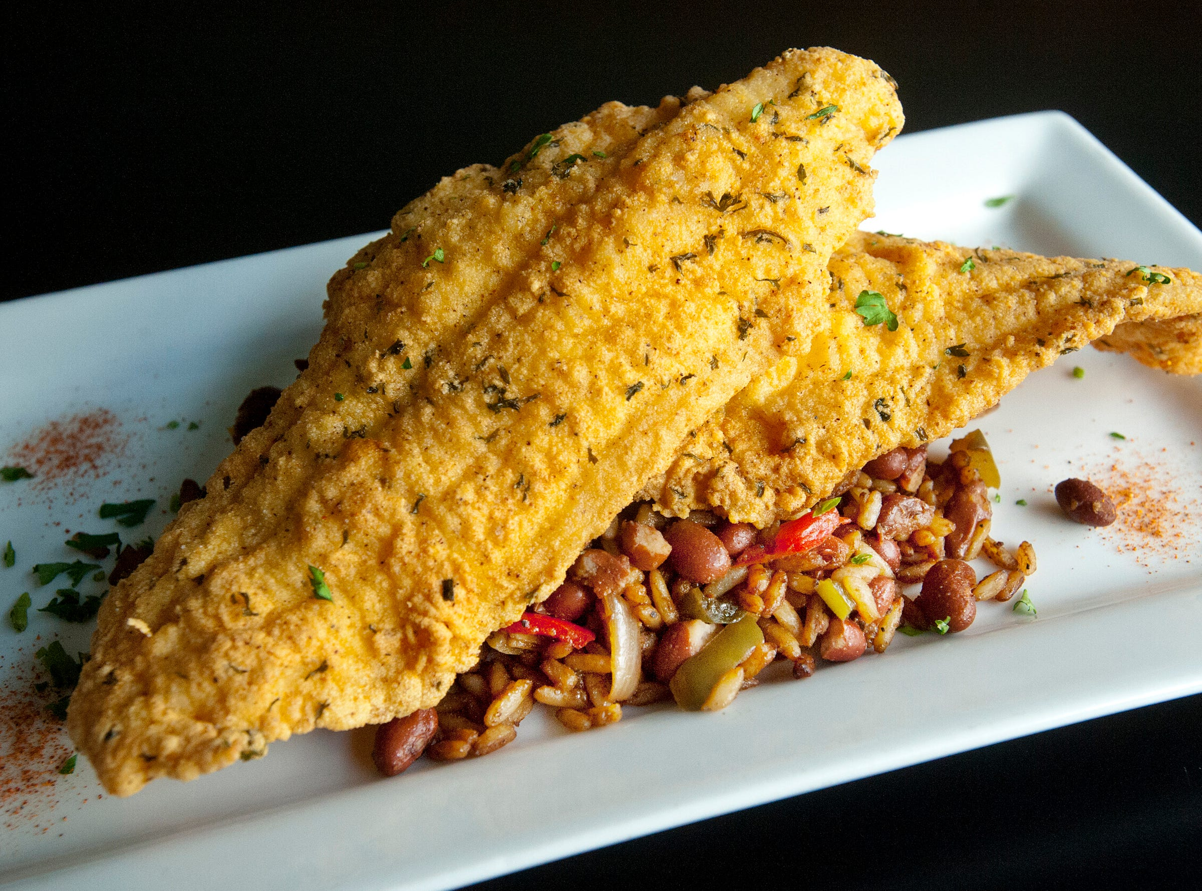 The Flavour Restaurant's fried catfish is made with a southern-style breading served on red beans and rice (other side dishes may be substituted for the beans and rice.) November 08, 2018
