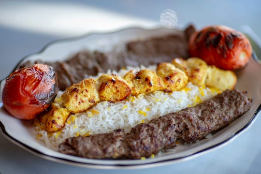 The Pesto's Signature dish at Pesto's Italian Restaurant on South Fifth Street in downtown Louisville features three juicy skewers filet and one skewer of marinated chicken breast on a bed of basmati rice. Oct. 18, 2018