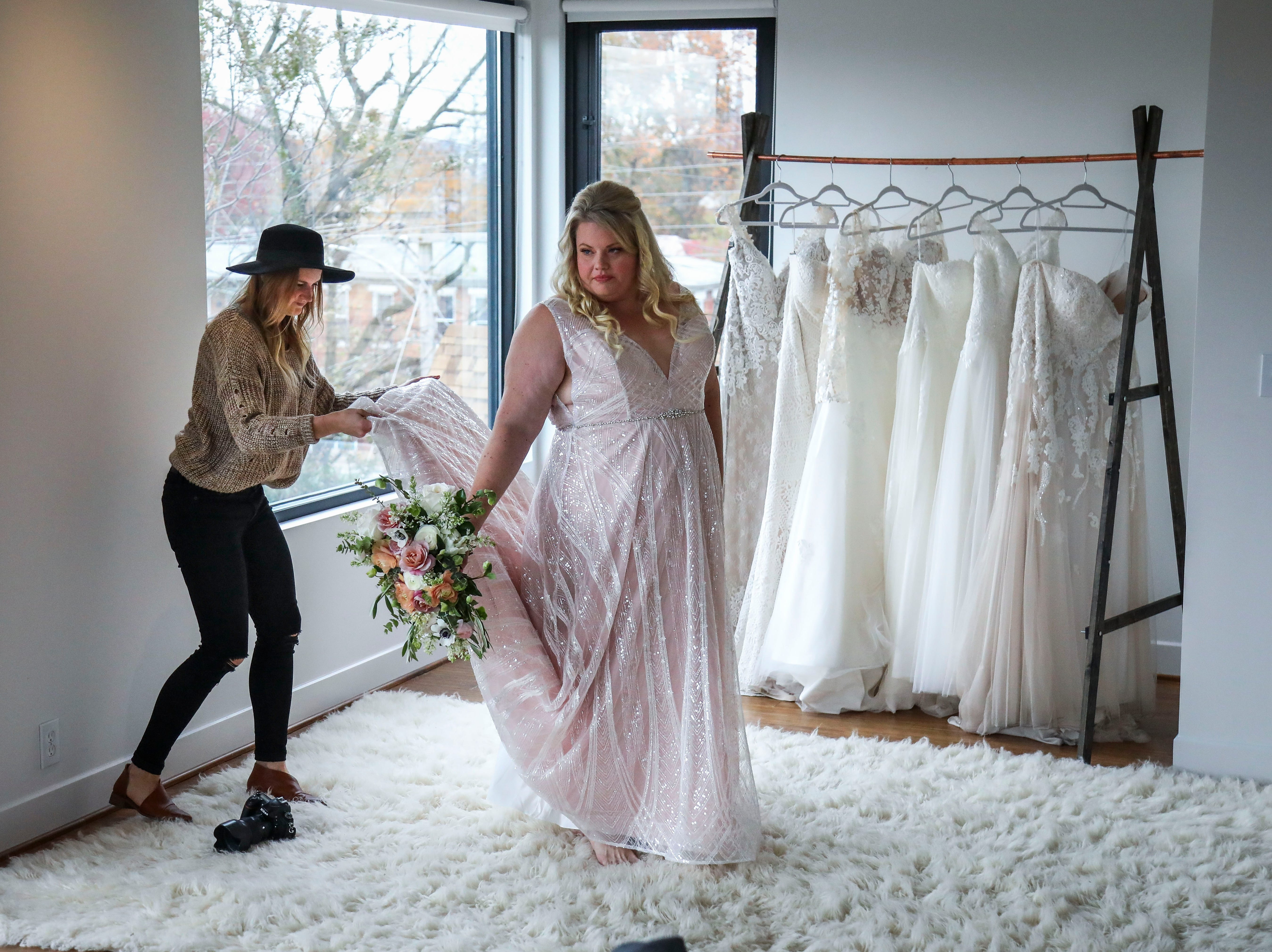 Susan Jordan of Love Hunters adjusts Misty Hair's Couture Closet Bridal dress during a photoshoot in NuLu in Louisville, Ky. on Monday, November 12, 2018. Plus-sizes make up only 16 percent of all apparel sales, though, 67% of women in the United States wear a size 14 or above. 