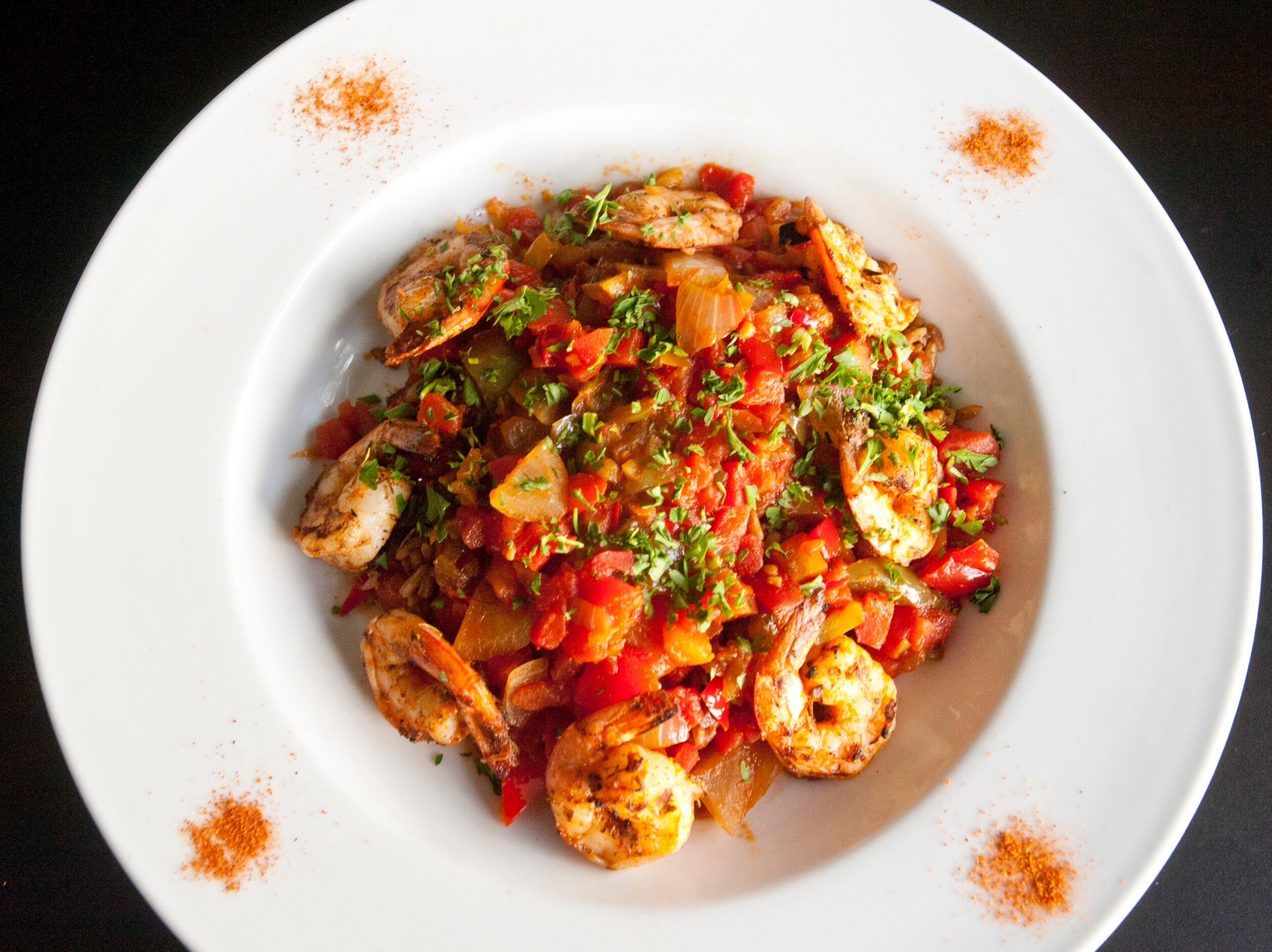 The Flavour Restaurant's shrimp creole is made with pan seared gulf shrimp atop onions, peppers and a spiced creole roux then finished with tomatoes, served over rice. November 08, 2018