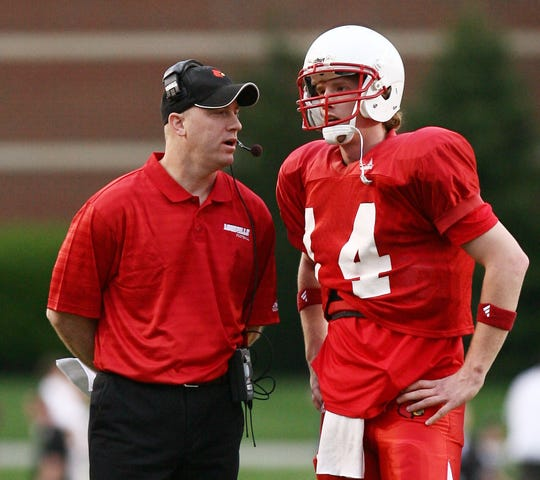 Then-Louisville assistant coach Jeff Brohm instructs quarterback Hunter Cantwell (right) during U of L's 2008 spring football game.