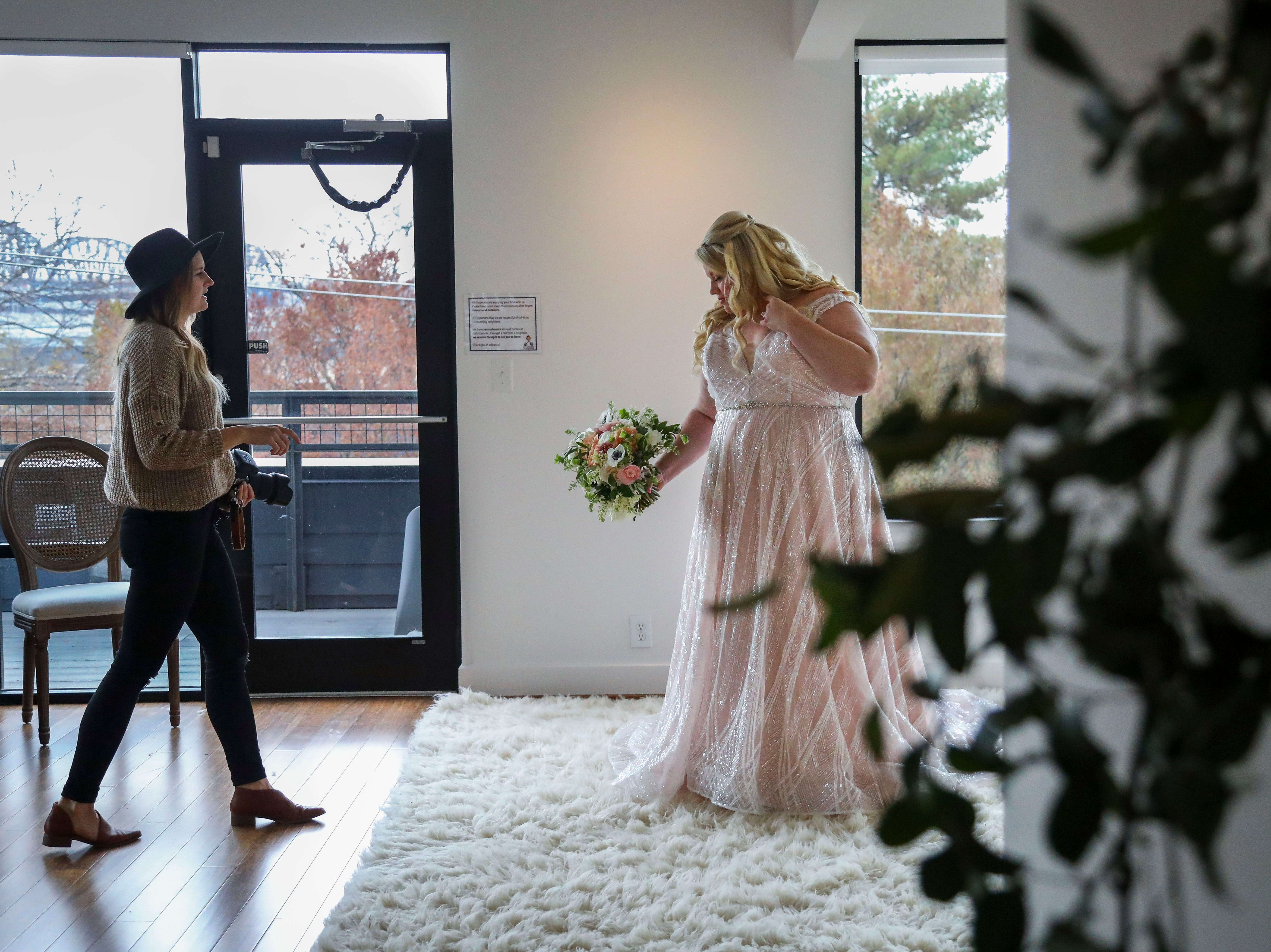 Susan Jordan of Love Hunters photographs Misty Hair, modeling a Couture Closet Bridal dress, in NuLu in Louisville, Ky. on Monday, November 12, 2018. Plus-sizes make up only 16 percent of all apparel sales, though, 67% of women in the United States wear a size 14 or above. 