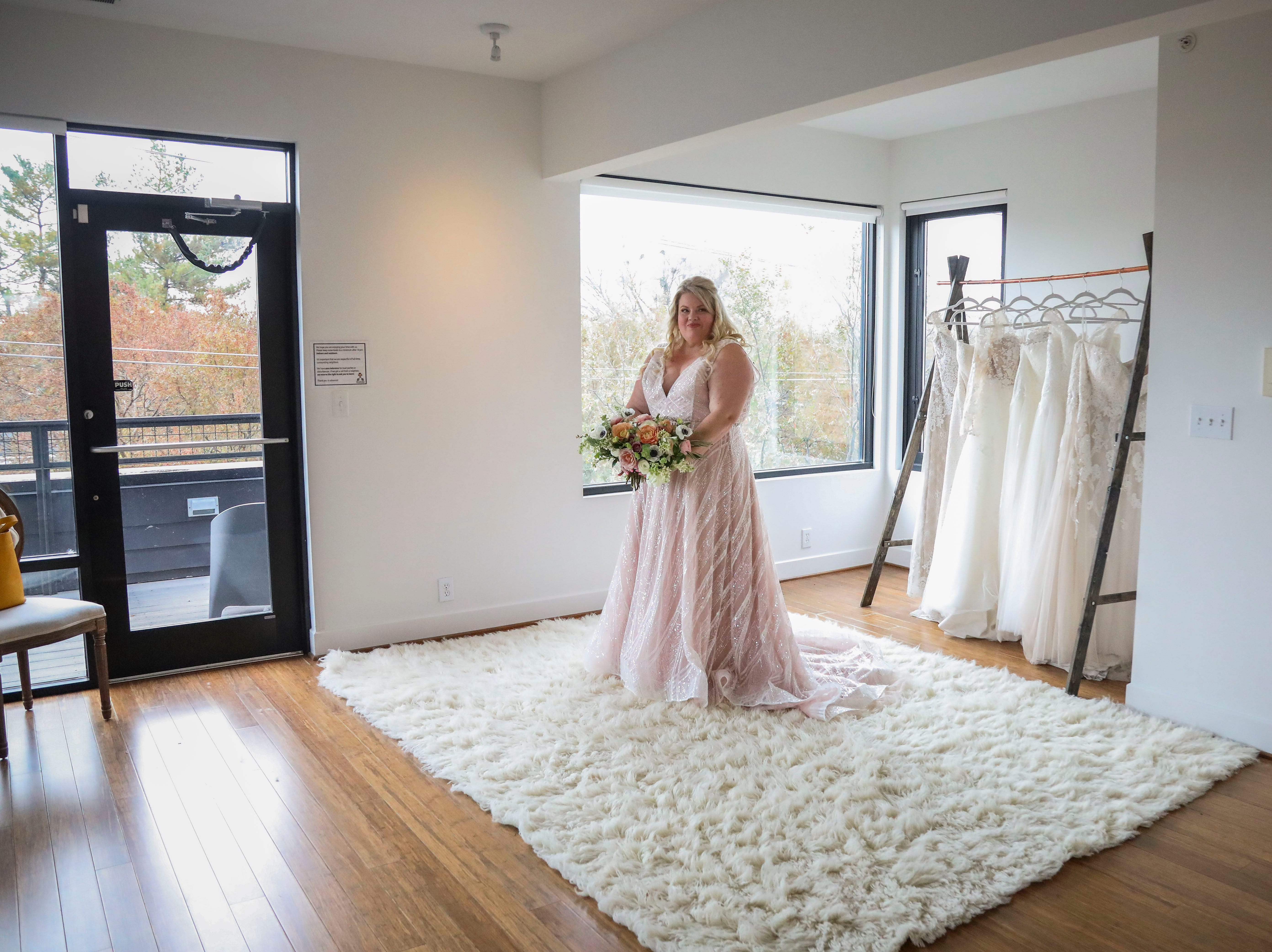 Misty Hair models a Couture Closet Bridal dress in NuLu in Louisville, Ky. on Monday, November 12, 2018. Plus-sizes make up only 16 percent of all apparel sales, though, 67% of women in the United States wear a size 14 or above. 